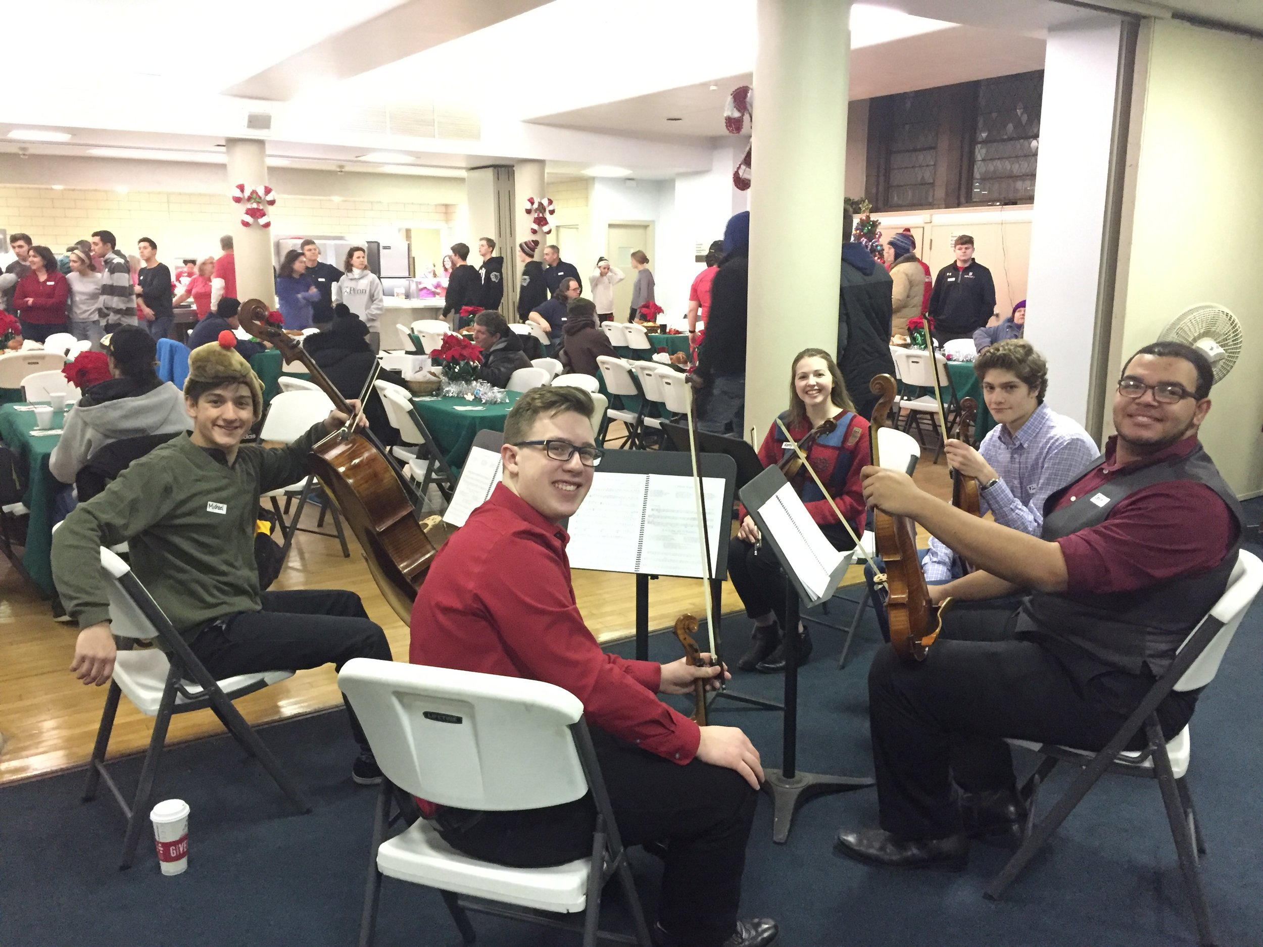 A Gift of Holiday Cheer - Tuesday, December 26, 2017A quintet of PYSO members and alum - Michael, Jimmy, Kerry, Zach, and Devin -performed for the downtown homeless community at their Tuesday night gathering, held every Tuesday night at First Presbyterian Church, organized by Outreached Arms ministry.