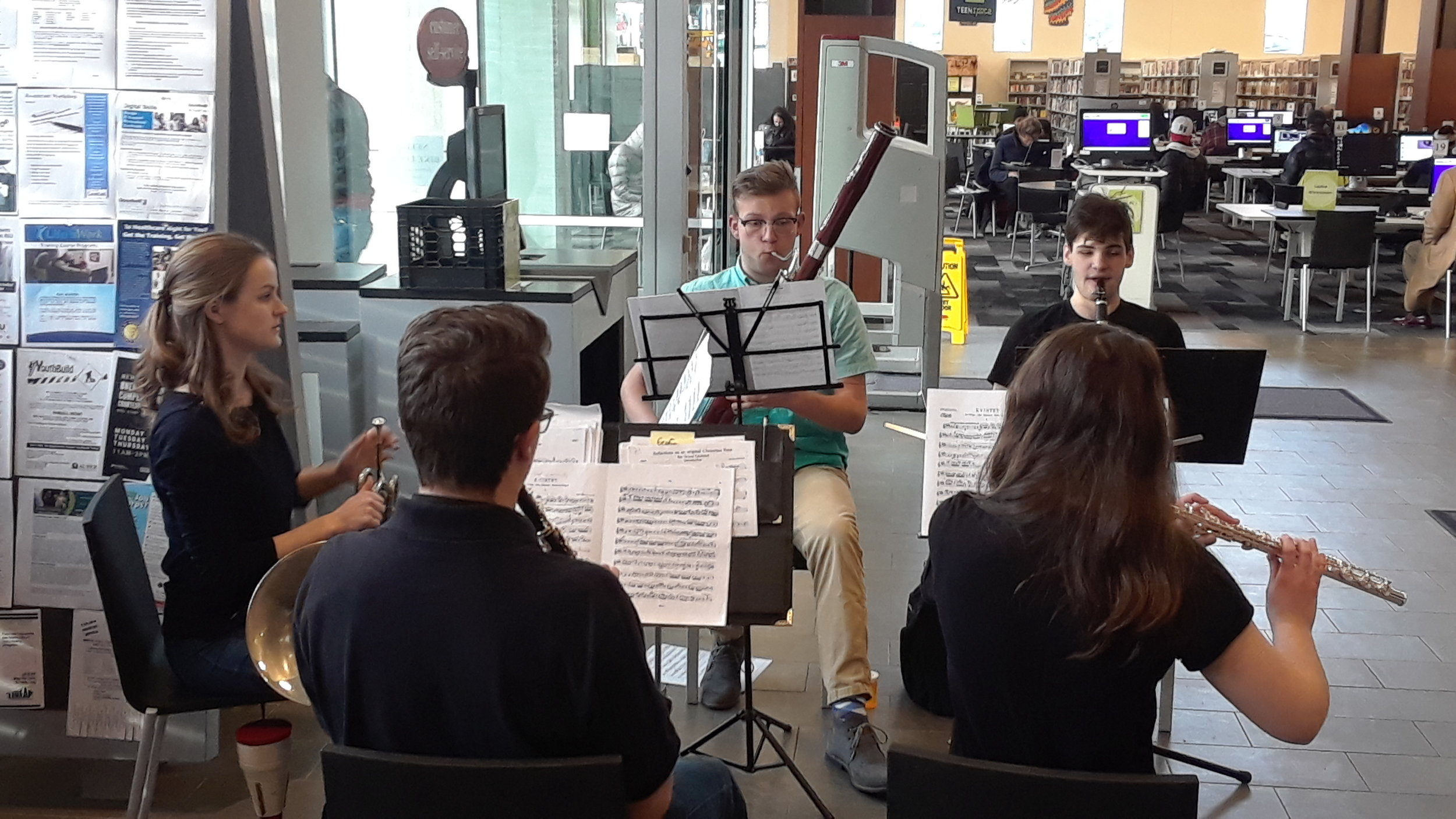 Holiday Pop-Up Concert - Sunday, December 9, 2018 - Wild Ginger Quintet - Carnegie Library of Pittsburgh AlleghenyThe Wild Ginger Quintet—Dinah, Geoffrey, Susan, Brody, and Nathan—performed a quintet by Carl Nielsen for library visitors.