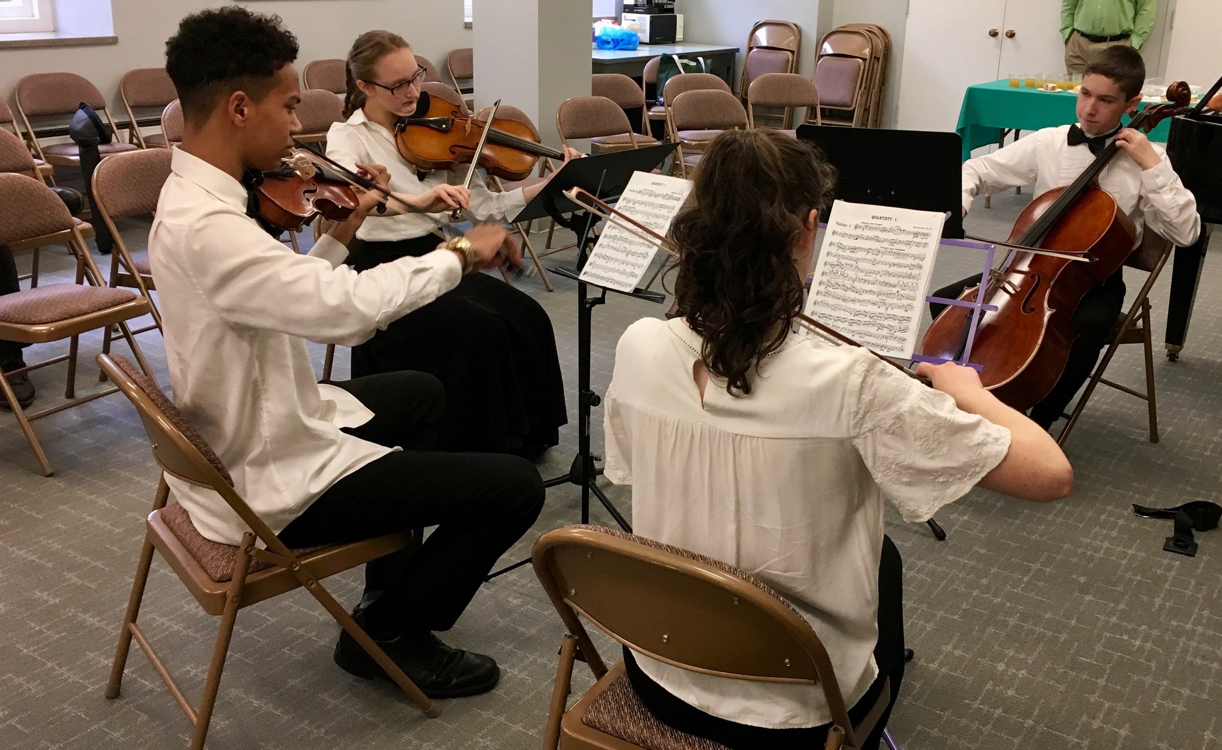 Fox Chapel Presbyterian Church - Sunday, May 12, 2019Two of our Saturday YC2 groups performed before morning worship at Fox Chapel Presbyterian Church as their Spring Recital. Pictured below, the Hoppledom Quintet - Pearl, Henry, Odette, Nyier, and Lincoln; and the Strings of Steel Quartet - Agatha, Dai'Quon, Odette, and Lincoln. Both groups are coached by PSO violinist Irene Cheng.