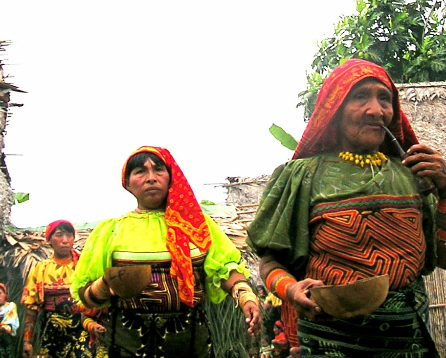 The Kuna women are taking part in a Chicha Fest, soon their bowls will be filled with Chicha, an intoxicating beverage. The fest celebrates the time a young girl becomes a woman. It involves much drinking, smoking and dancing!