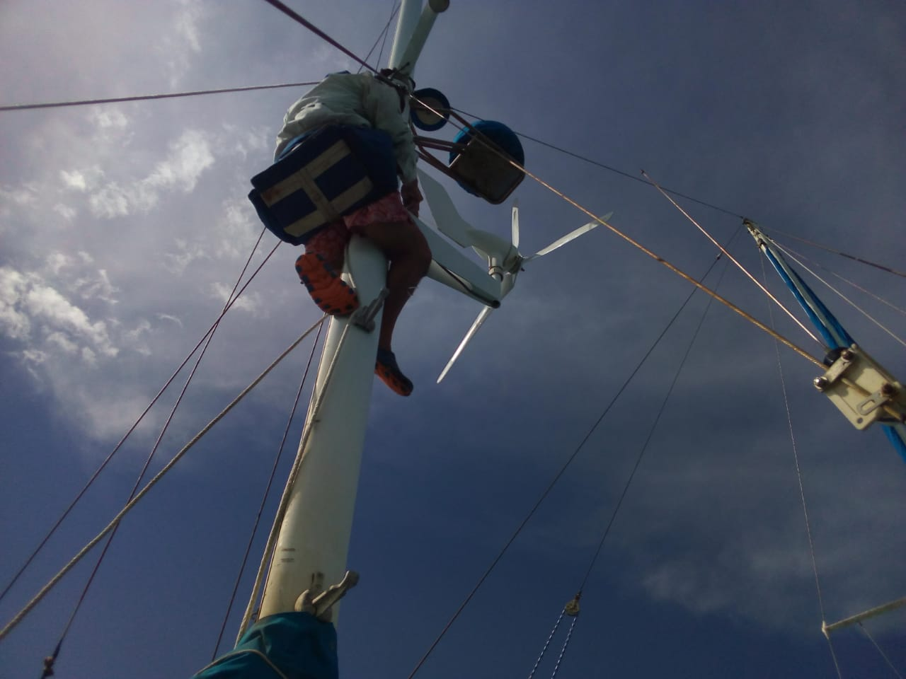 Breeze replacing blades on wind generator.jpg