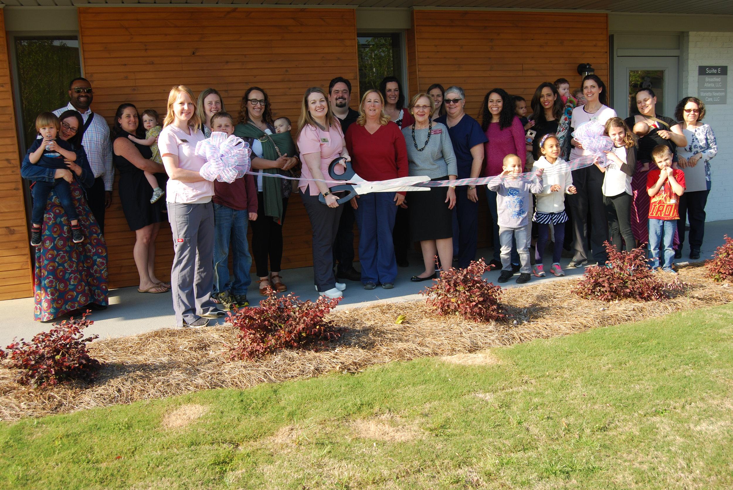 Ribbon cutting celebrating the opening of Breastfeed Atlanta Northwest.
