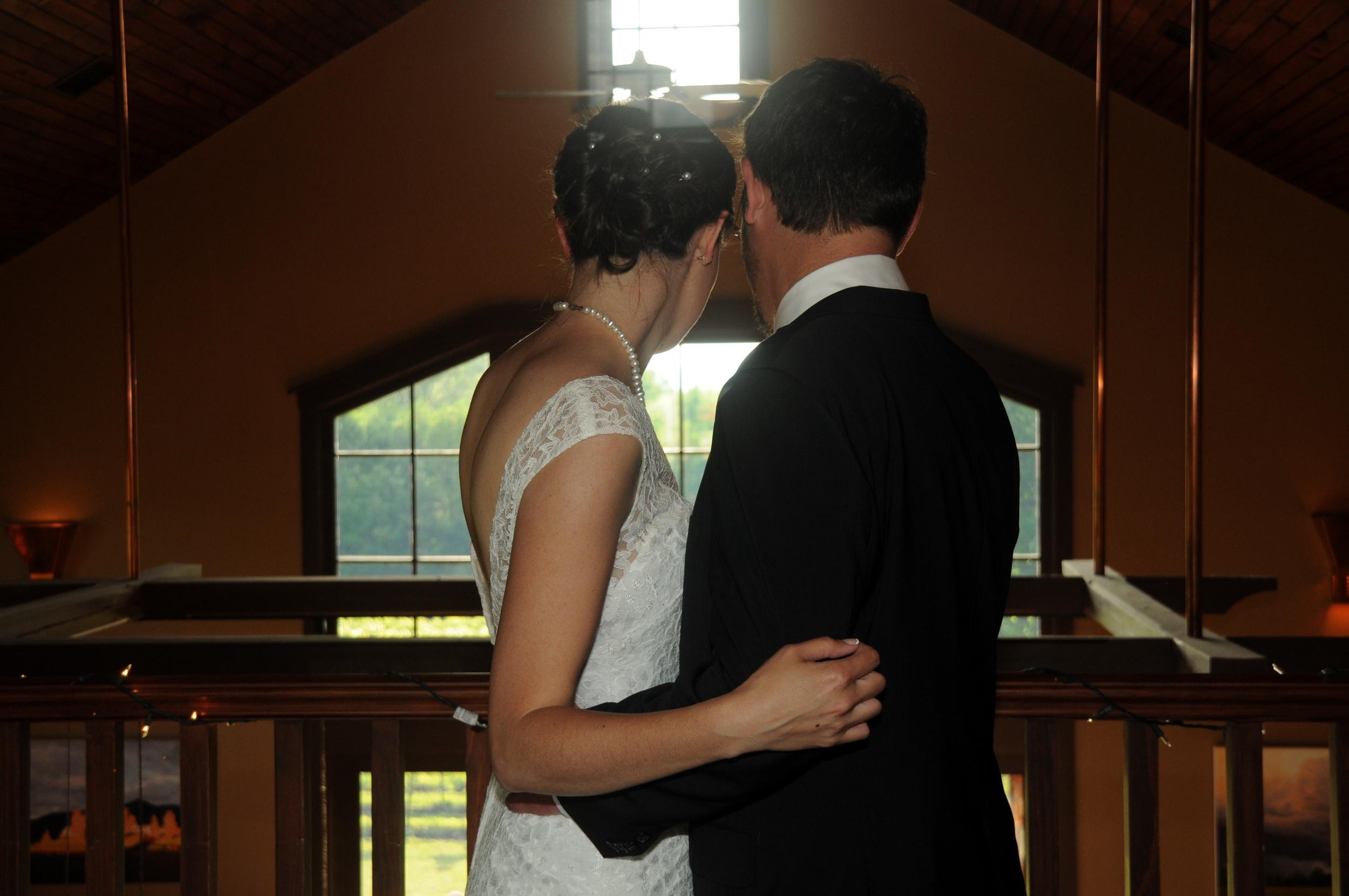 bride and groom overlooking the tasting room.jpg