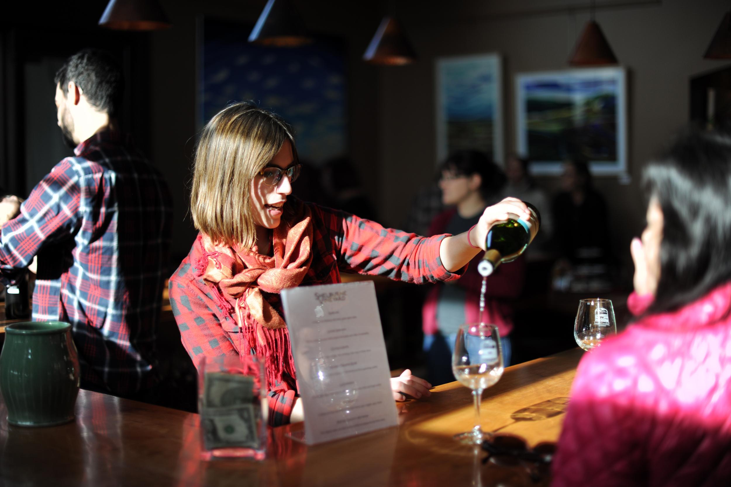tasting room staff pouring wine