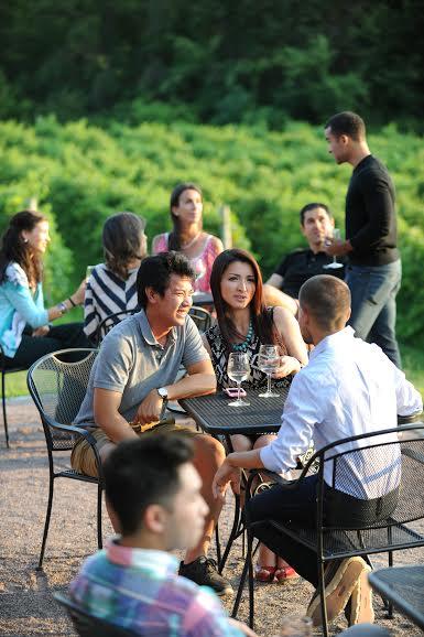 People enjoying wine outside