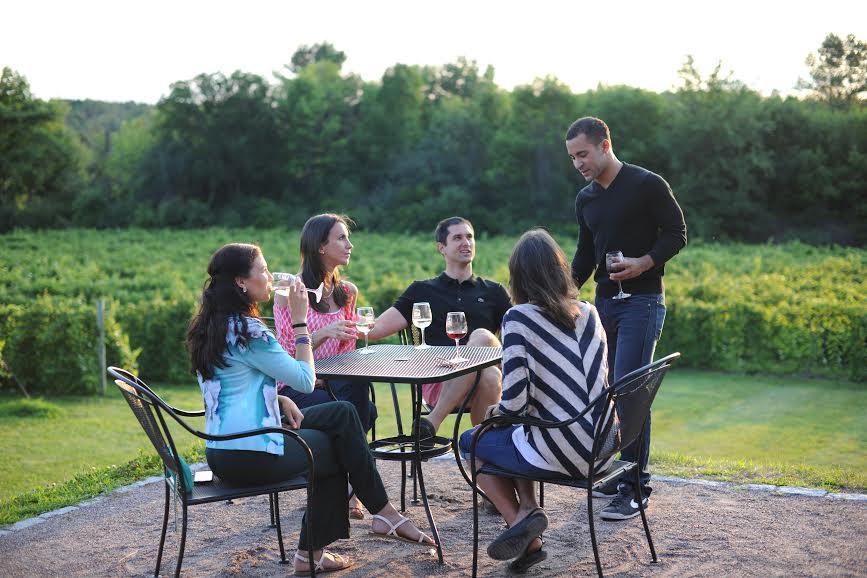 group enjoying wine on the patio.jpg