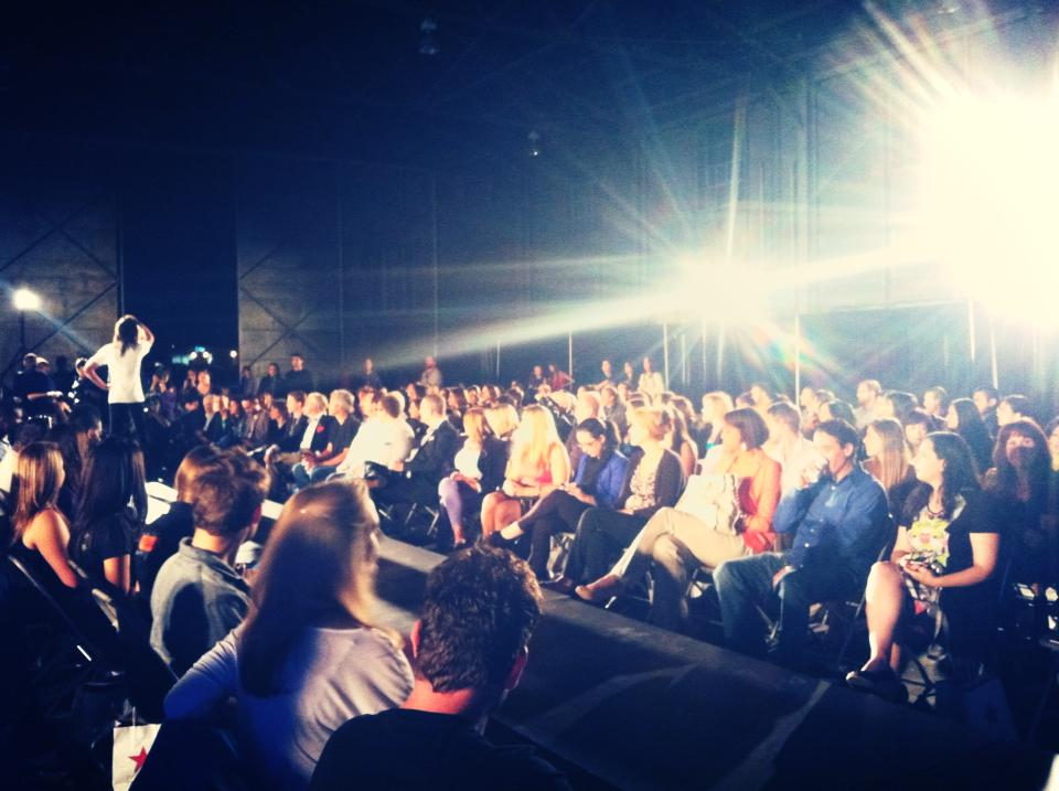 300+ guests watch models strut their stuff on the runway at the University Air Center