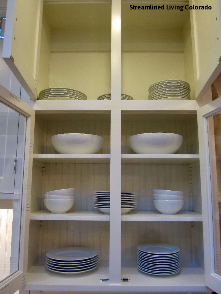 Part of this large project entailed figuring out where kitchen items would be stored and discreetly labeling inside the cupboards and drawers. The overflow for everyday dishes was directly above the cabinet.