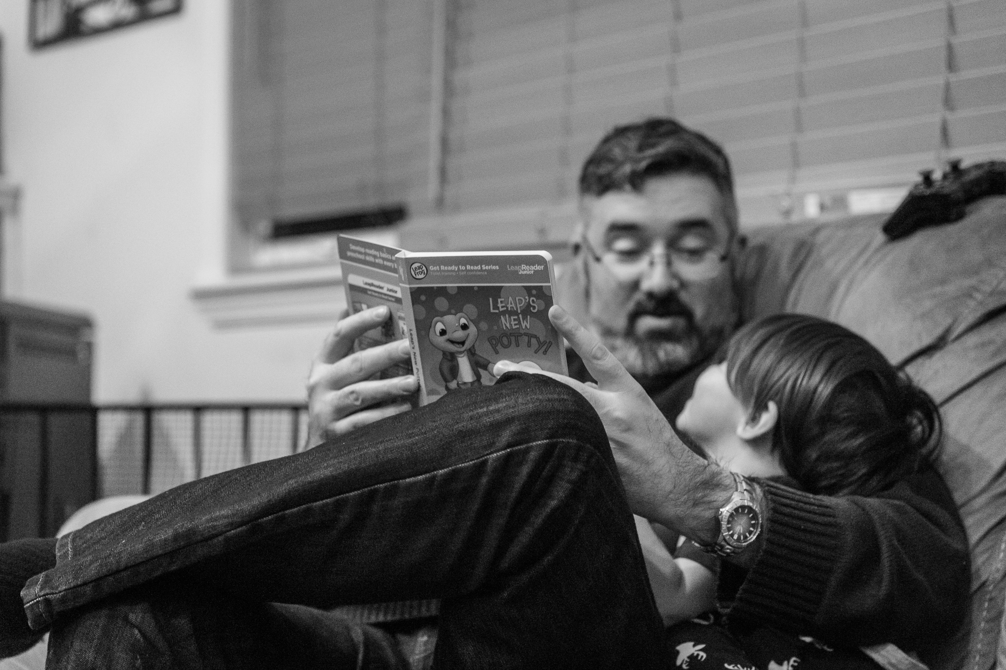 My husband reading to our son after his bath. He just finished potty training so they are reading the potty training book together. I cannot believe how fast he is growing. I am so glad I have these images to remember it all.