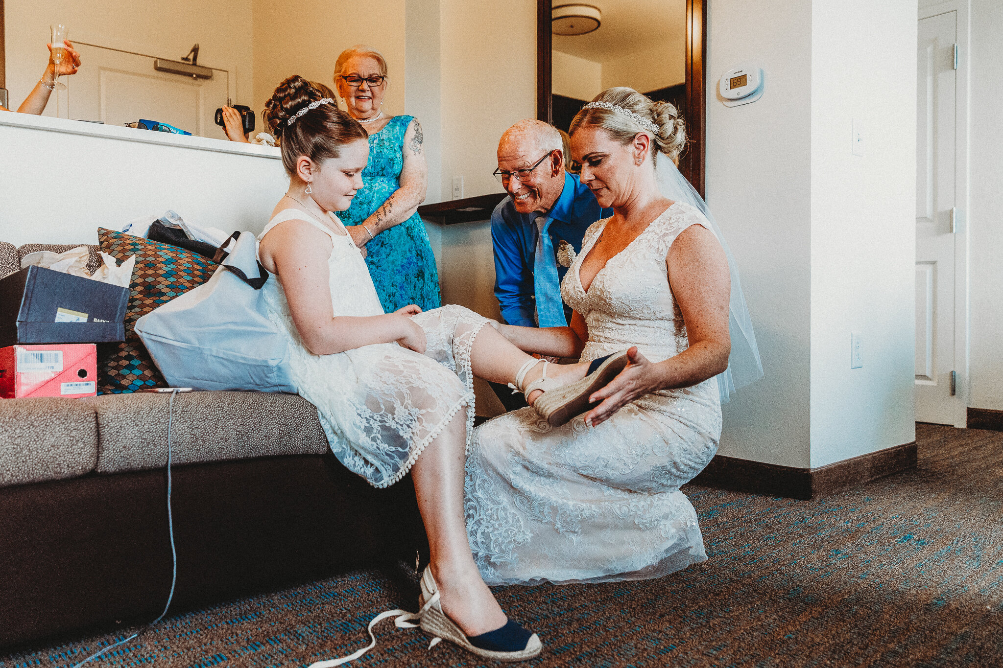 I adore this image of the Grandparents looking on as the bride puts her daughter's shoes on.
