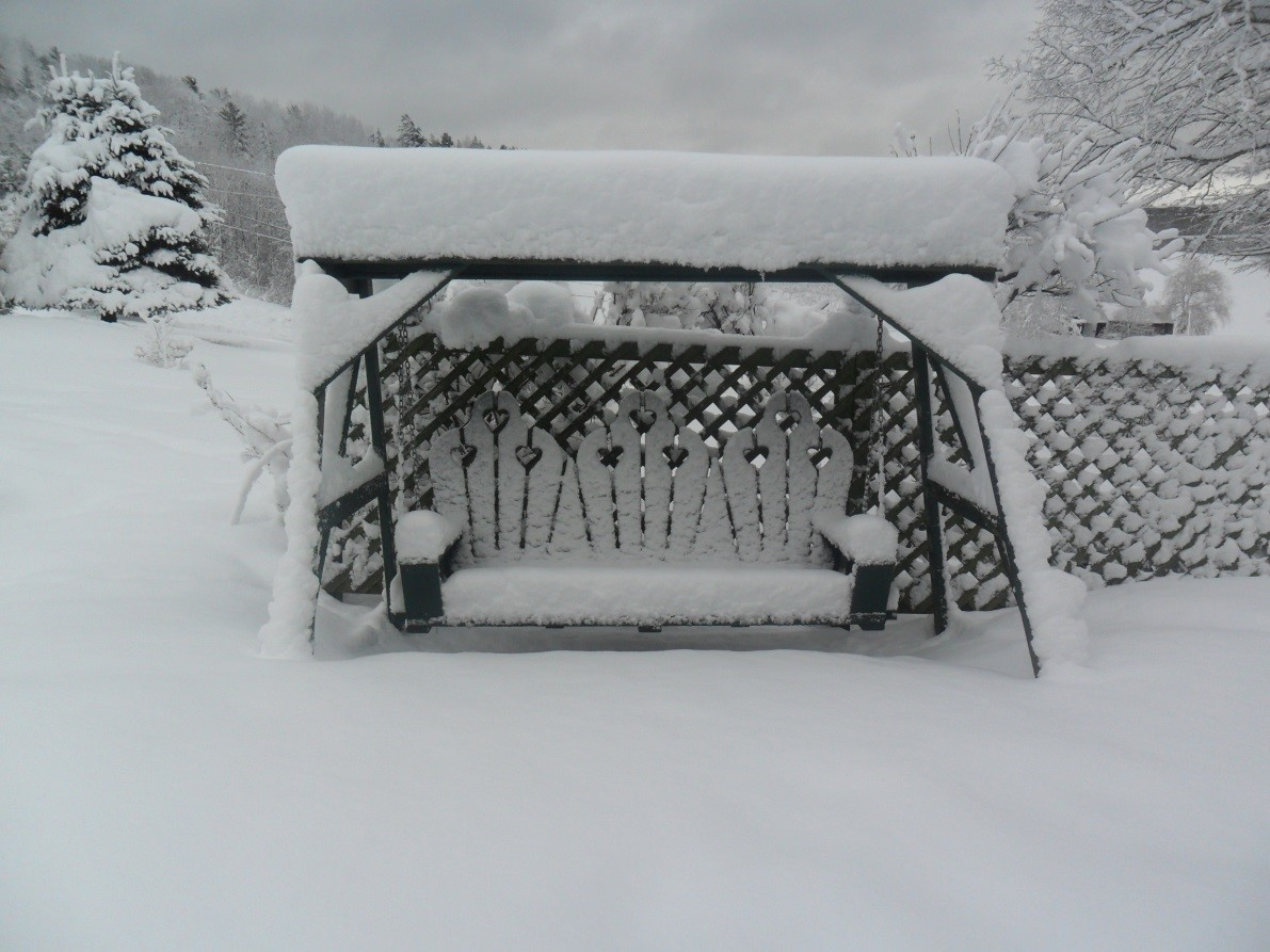 A little snow in my backyard for swinging and reflecting