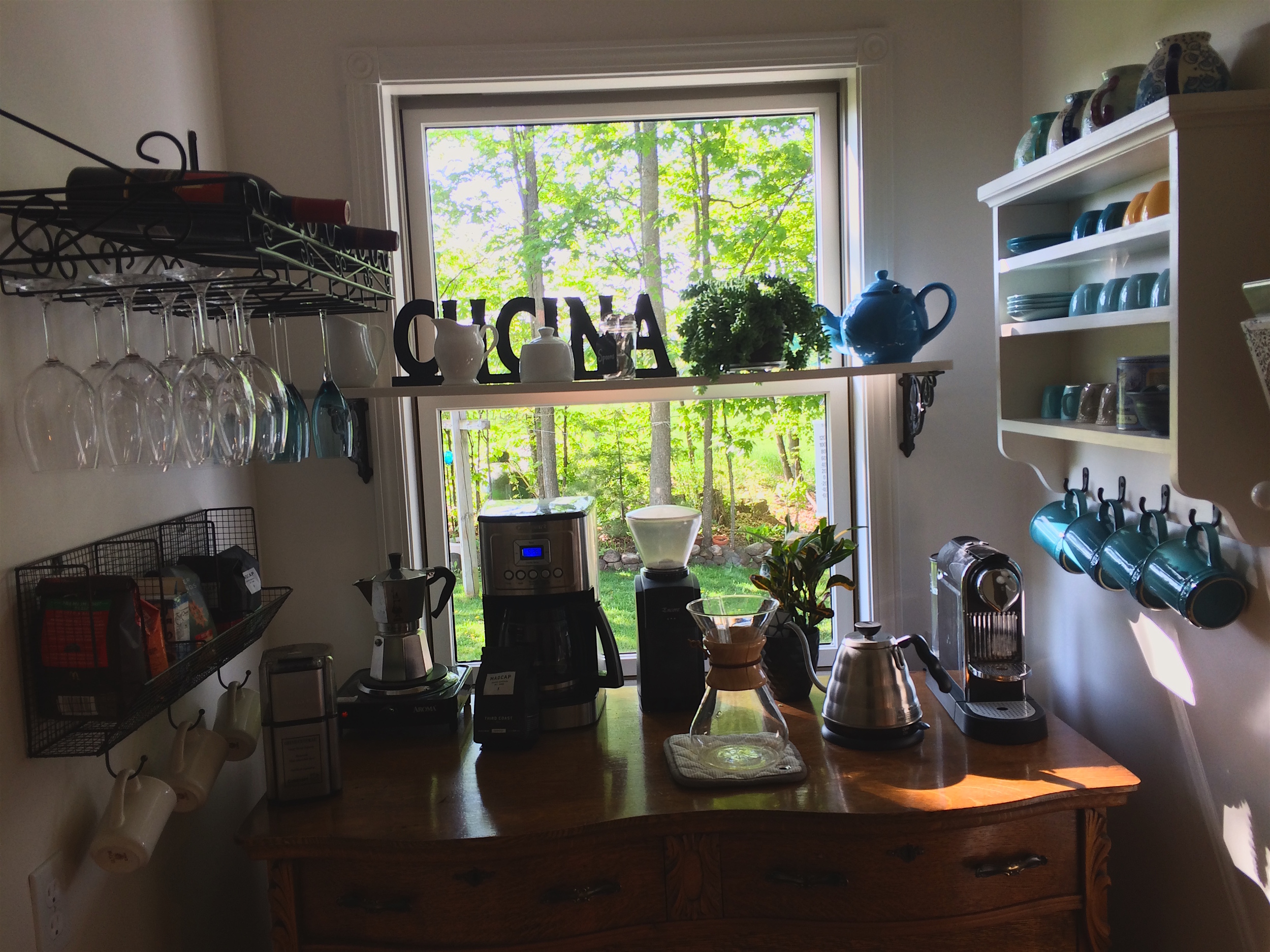 My mom's coffee bar.  A nice mix of the Italian Moka pot on the left, an American drip coffee machine, Chemex, and a French Nespresso machine.