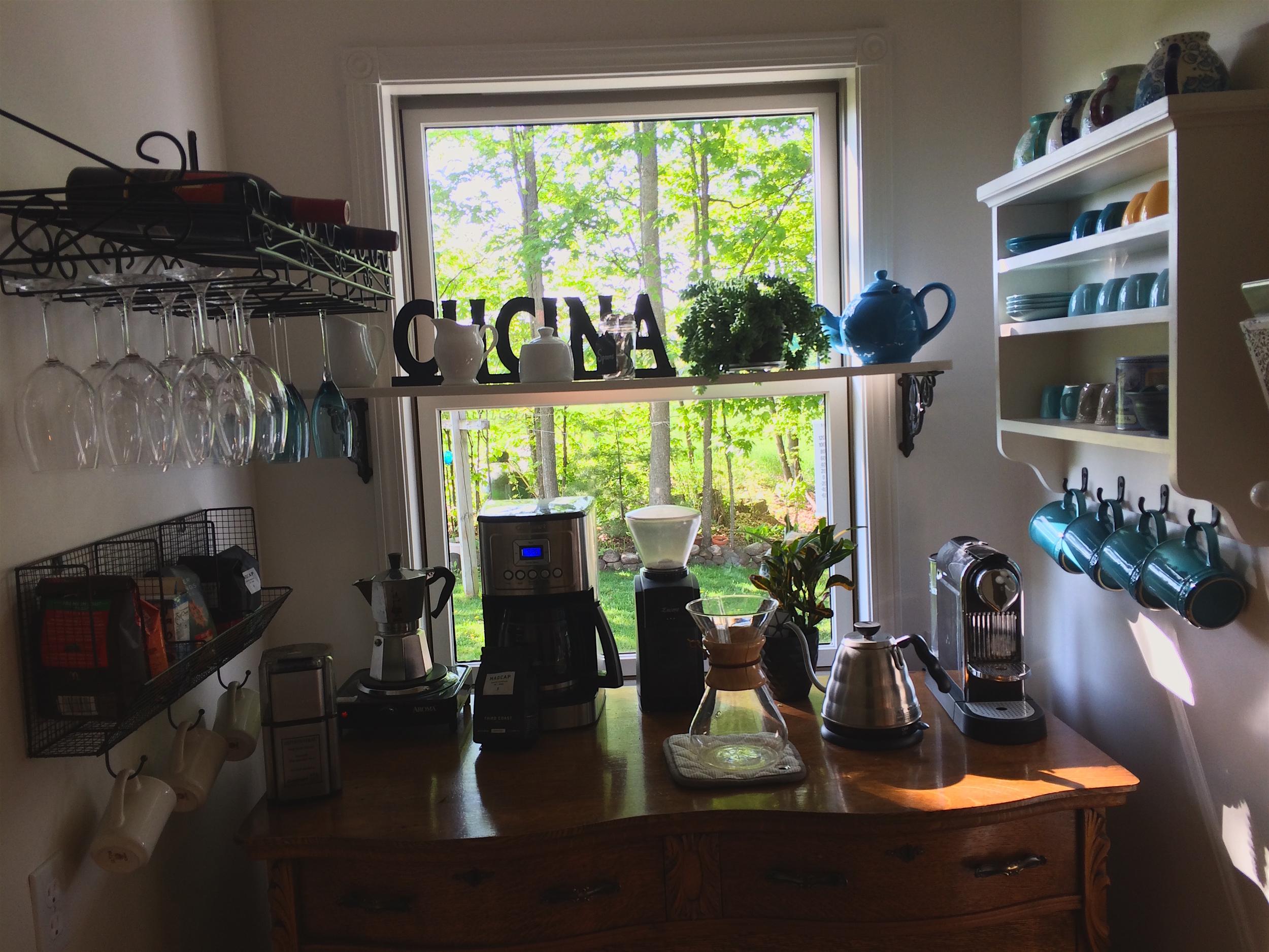 My mom's coffee bar. A nice mix of the Italian Moka pot on the left, an American drip coffee machine, Chemex, and a French Nespresso machine.