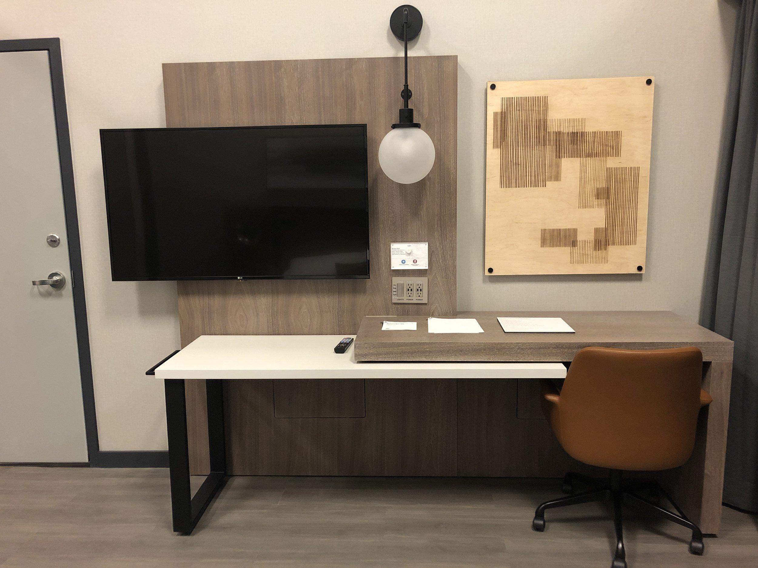 Textural art and retractable desk.