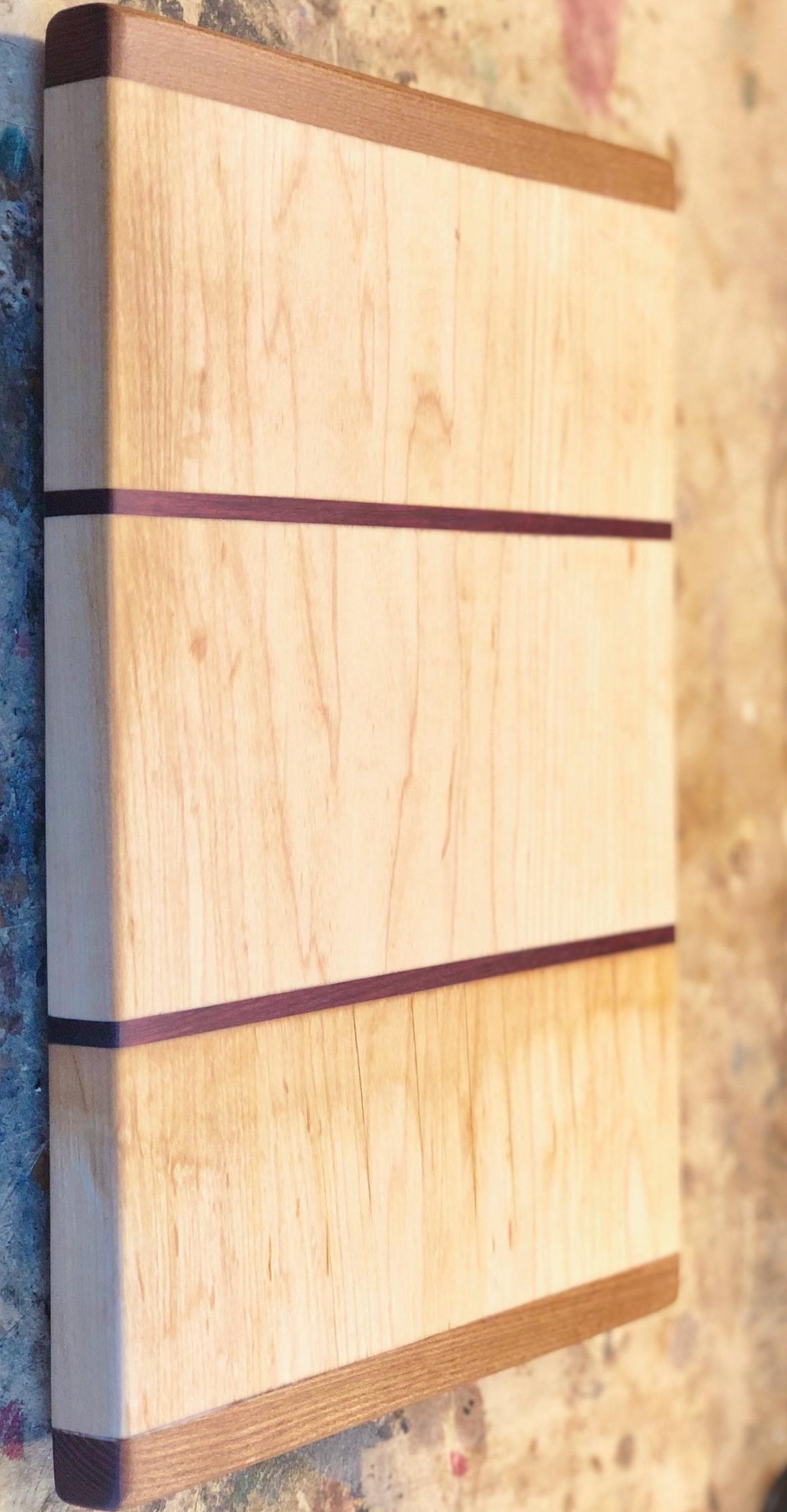 Maple, walnut, andpurpleheart cutting board—$75 - 9 x 13 x 1.5 inches