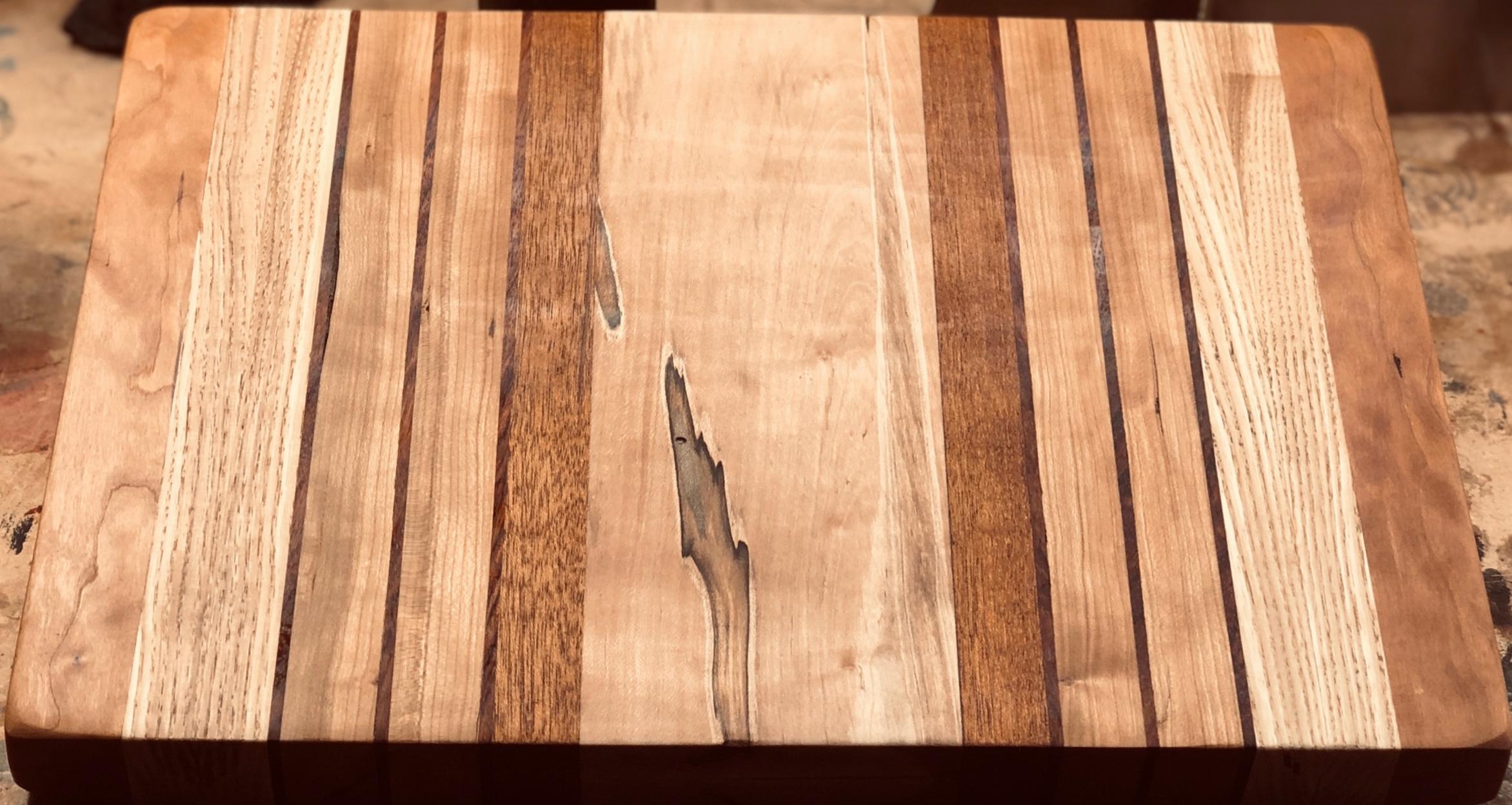 Beautiful hardwoodcutting board—$90 - 15 x 12 x 1.5 inches