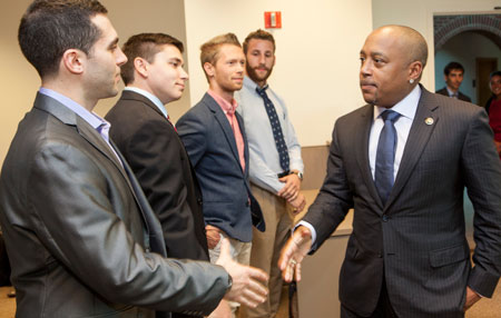 "Daymond John of ABC's hit reality show, ""Shark Tank,"" met with business students at QUCIE office before a public lecture."
