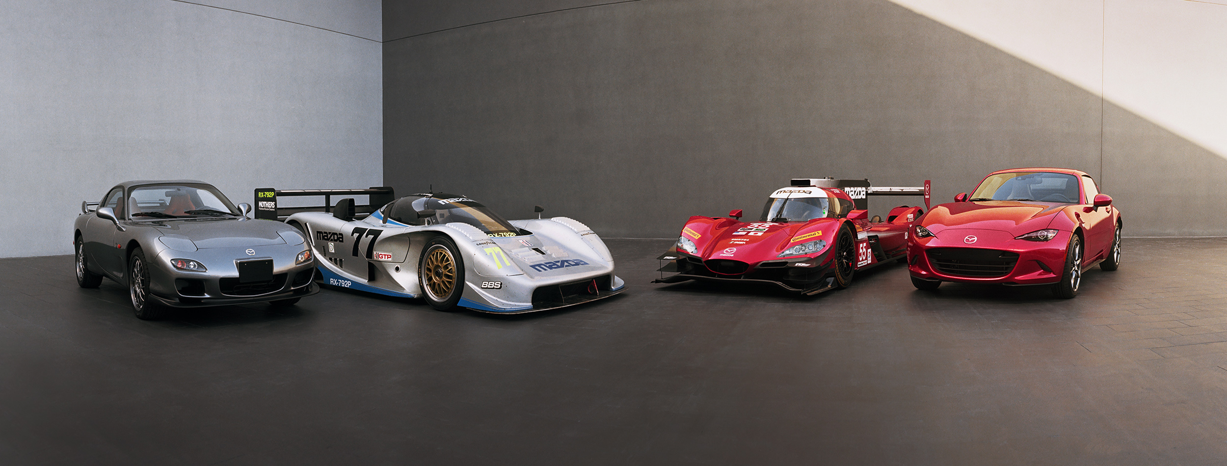Two racecars, two road cars