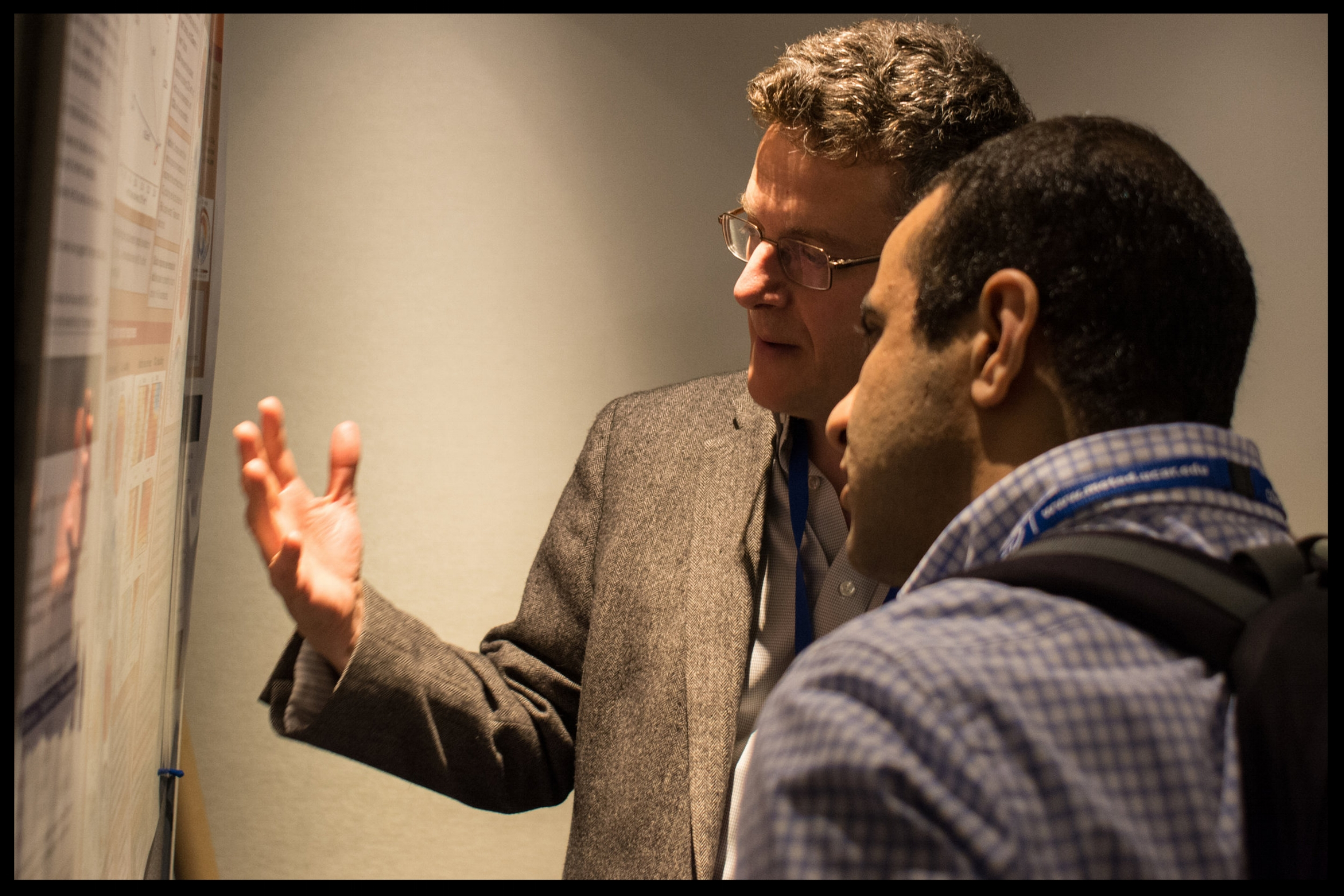 Paul, with Ali Moridnejad, discussing Kelly McCusker's poster at the 2017 CMOS Congress in Toronto. Photo by Dan Weaver.