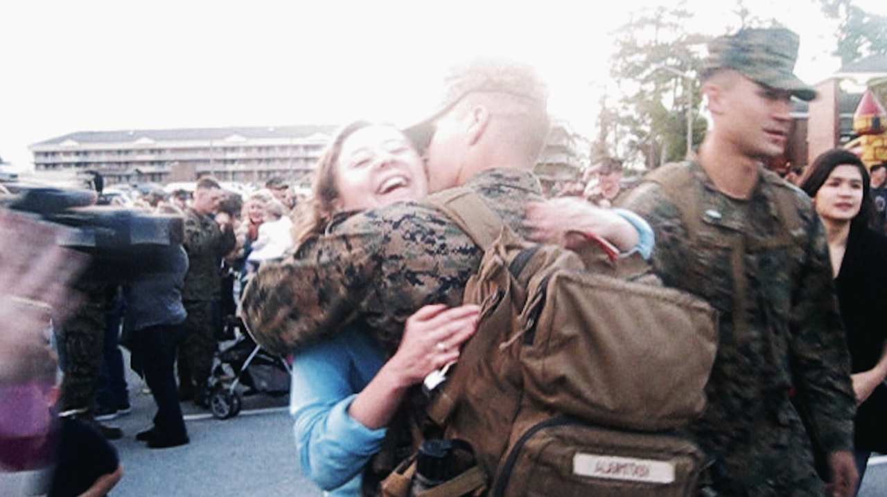 """This is Brooke and her husband Peter.  Peter was deployed on a ship at sea with the Marine Corps for 8 months. They had only been married about a year when he was deployed. When we got home, Brooke traveled 14 hours from Michigan to North Carolina to see him.  Brooke's Facebook post from that day:   """"Got pulled over today Officer said: Do you know the speed limit on this freeway? Me: 60mph? Officer: Yes. And you were going 81. Any particular reason why you'd be going so fast? Me: MY HUSBAND IS GETTING HOME FROM DEPLOYMENT, SIR! I GOTS TA GET TO NORTH CARALINA ;) """"  (She did end up getting a ticket, but admits that she deserved it)  """"I remember scanning all of the faces under the covers to find my Peter. It took a few minutes for us to find each other amidst the mob. We embraced and held each other tight. It was all worth it."""""""