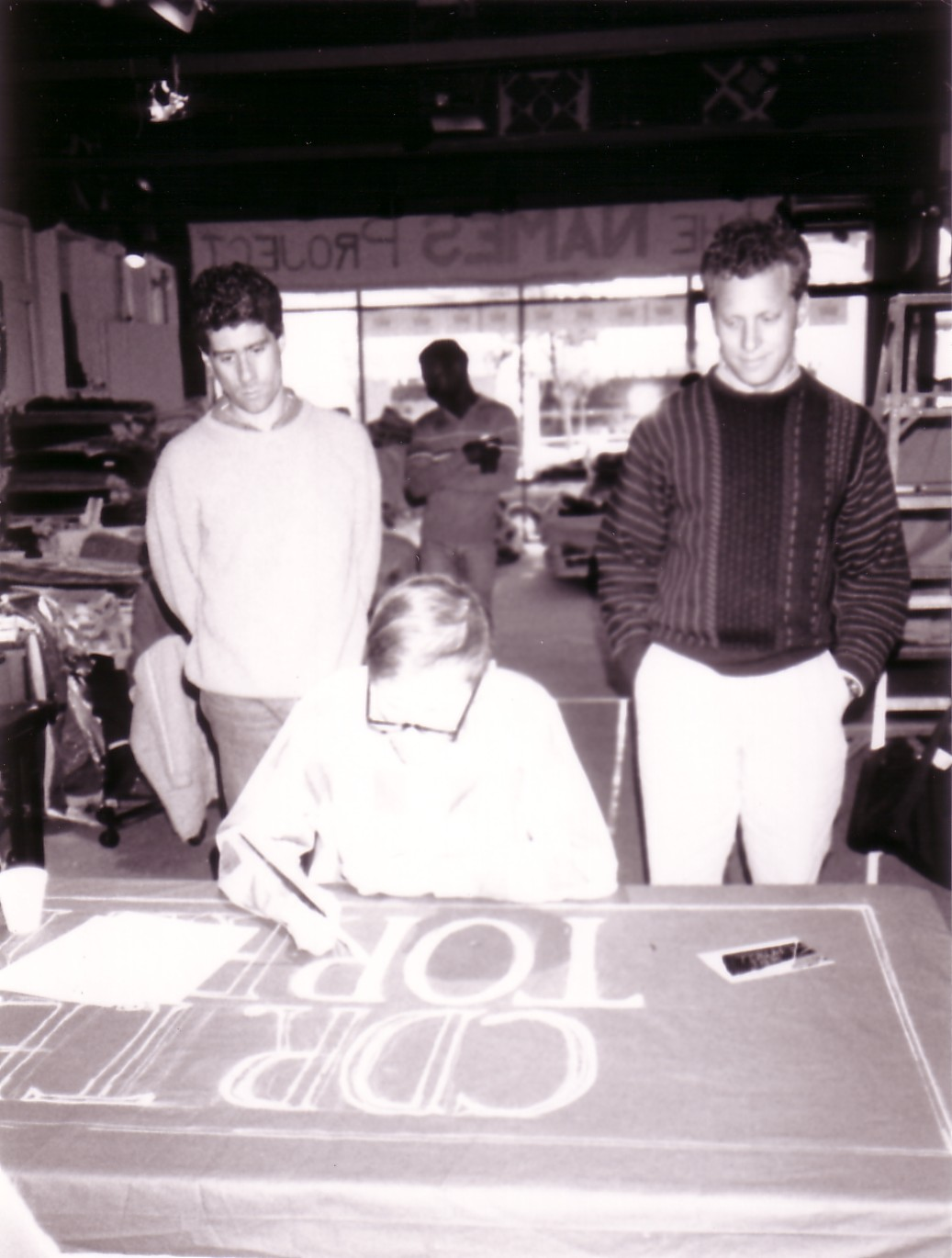 5.  Jeffrey and Rob watch as Tracy Torrey paints his own pan.jpg