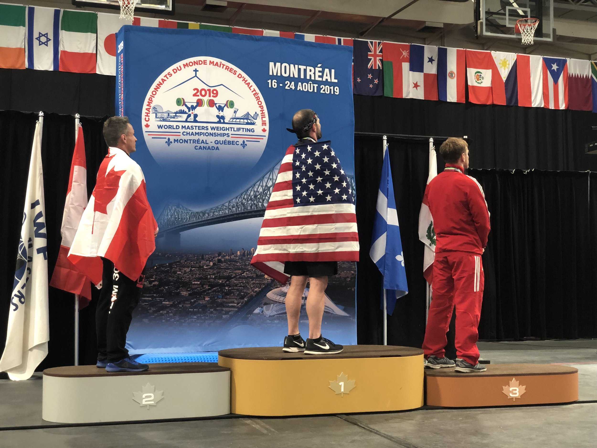 Coach on the podium at the World Masters