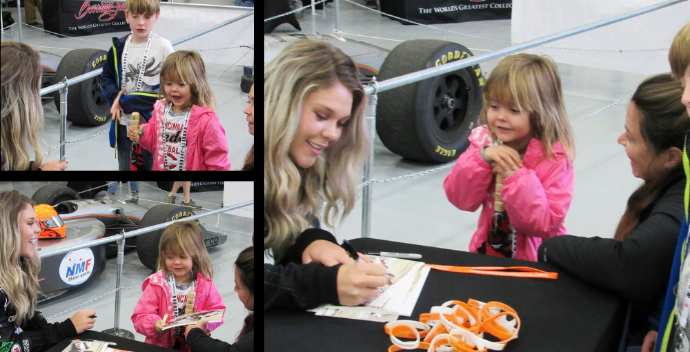 A young fan savors her signed picture from MIanna.