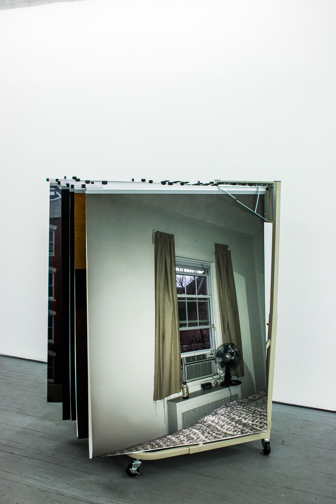 "Tzirel Kaminetzky's ""Soft Archive,"" a sculpture of large scale iPhone photos that are at once stunning and mundane, and Sarah Brewington's ""Present,"" a nonspecific cityscape constructed from images on mirrors captured on expired film, scanned and printed, both have an implacability."
