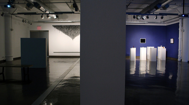 """""""Passage,"""" art critic Michael Brenson noted in his 2004 essay collection  Acts of Engagement: Writings on Art, Criticism, and Institutions, 1993-2002 , is a word pregnant with antagonisms: 'exit, trap; fright, play; hiding, exposure.'"""" Brenson continues, """"Because of its associations with the middle passage as well as the free travel and transformation, passage is marked by both enslavement and liberation."""" It also calls to mind another famous route, the Northwest Passage, a shipping route across North America that remains ever on the edge of possibility and therefore ever entrenched in the imagination. We speak of passages of text chosen for their particular poignancy and of rights of passage, processes of change and becoming. The passage of time connotes both continuity and transformation. The Silk Road, too, might be called a passage, an exchange of commodities and culture between once distant worlds. It finds its modern descendant in the highway, the arterial system of travel and commodity exchange. Passage, of course, is not merely a route but a movement, a working through, a transformation of space, time and psyche.  The works in this exhibition are in various states of passage. They address the movements of commodities and bodies through time and space, as well as the movement of time and space itself."""