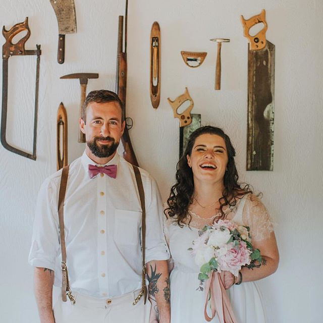 Sara with Thom in their beautiful home. Sara handmade her dress, Thom's shirt, plant dyed his bow tie and the ribbon in her bouquet. They even made their own shoes for their celebration. I have the most inspiring and sweet friends. 🖤 Photo by @sweet_heirloom  Bouquet @jeanieandroid  Sara's makeup done by her sis @rachel._nelson  Thom's cut and Sara's style by moi.