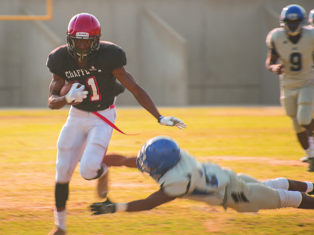 Cameron Coleman runs the ball at Grigby Field during the scrimage against SBVC. Photo by Michael Ravenelle.