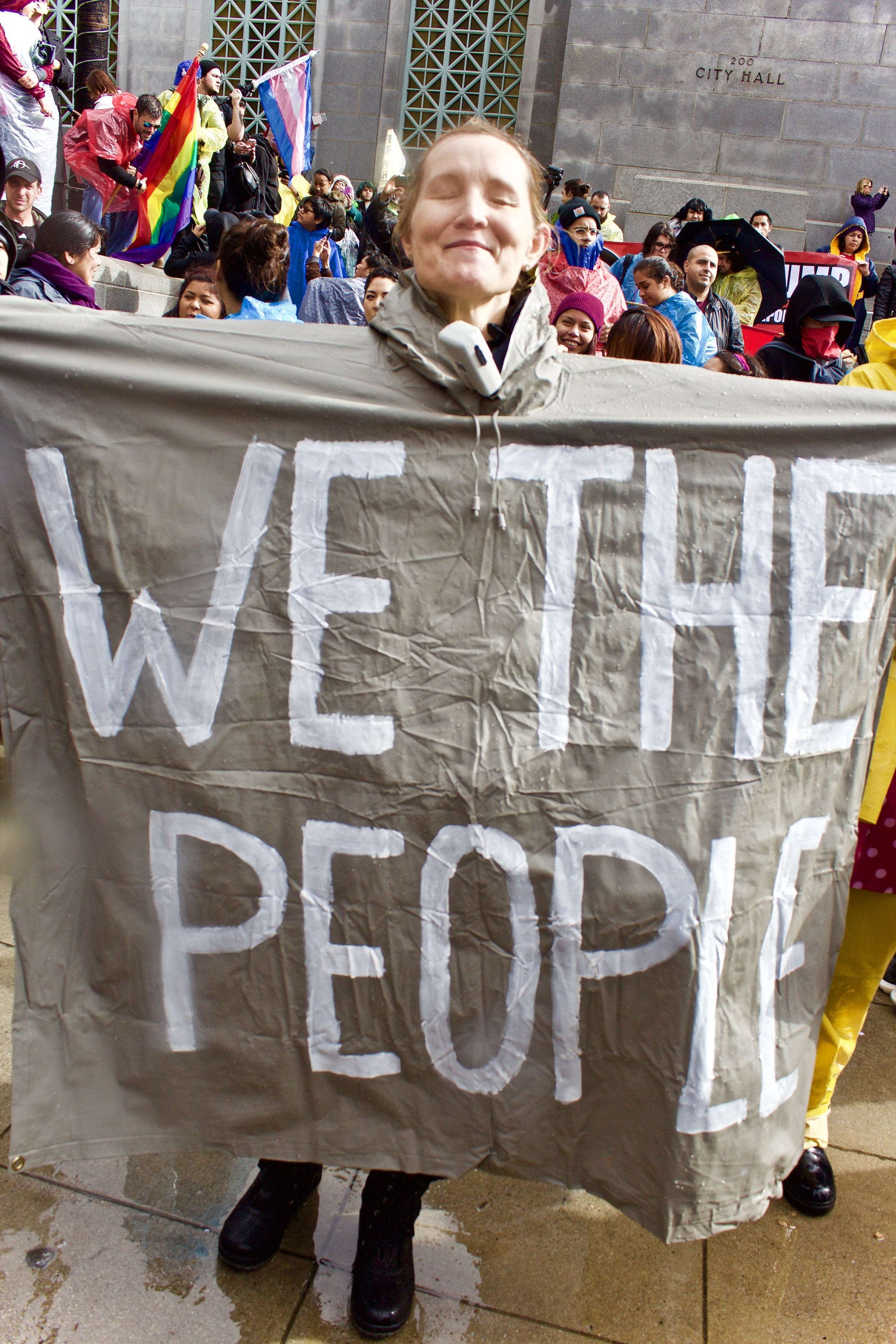 """""""We the People"""" painted on a poncho."""
