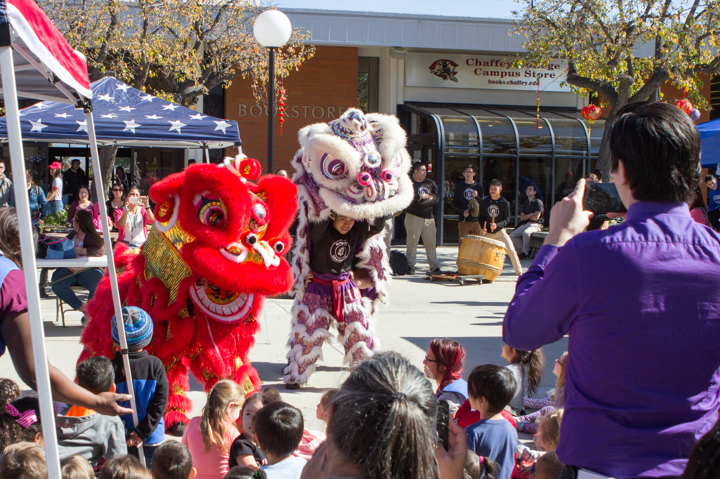 Performers from the Ane Thanh Lion Dance bring their costumes to life with chomping jaws and flapping ears while their musicians play in the background on Wednesday, Feb. 1, 2017. Photo by Christopher Santee.