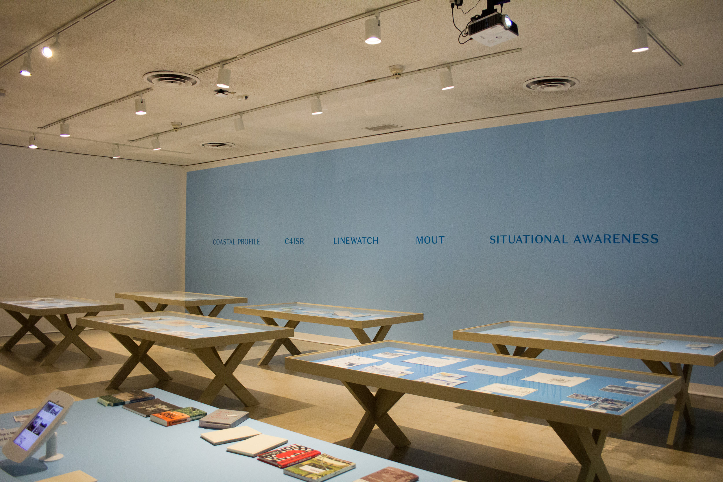 Tables from Incendiary Traces each detail different locales that Mushkin and others explored  through art and public research. Photo by Christopher Santee.