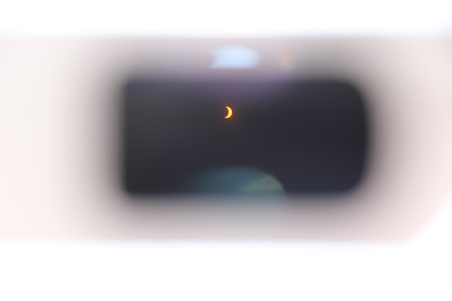 What it looks like to see a partial solar eclipse through Eclipse Glasses. Photo by Jullian Aiden Bravo