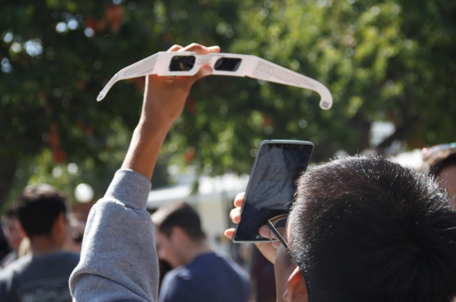 Nathaniel Zamora, engineering major, attempts to capture an image of his first partial solar eclipse on Aug. 22. Photo by Jullian Aiden Bravo