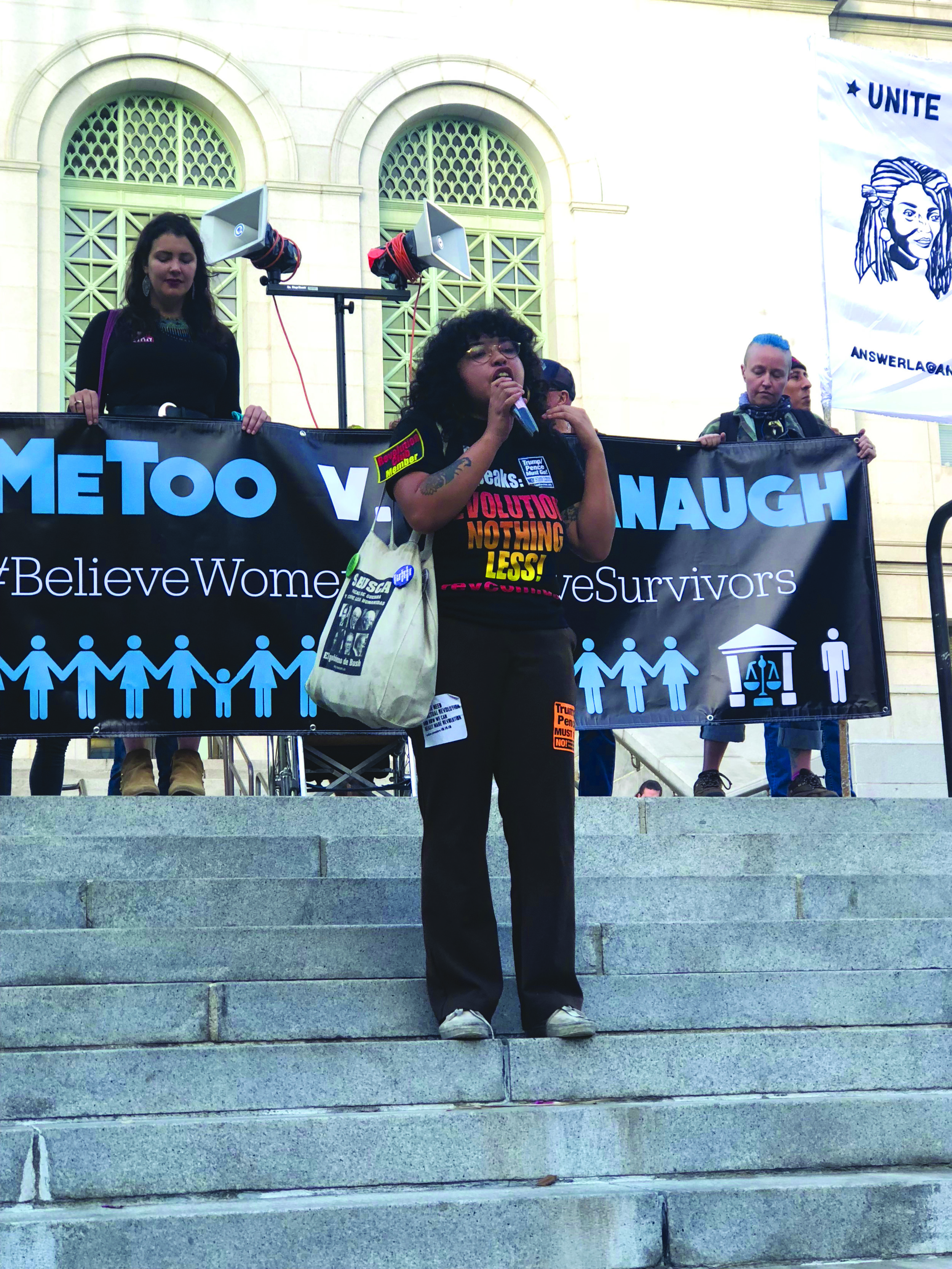 Luna Hernandez from Revolution Club L.A. speaking on the steps of City Hall