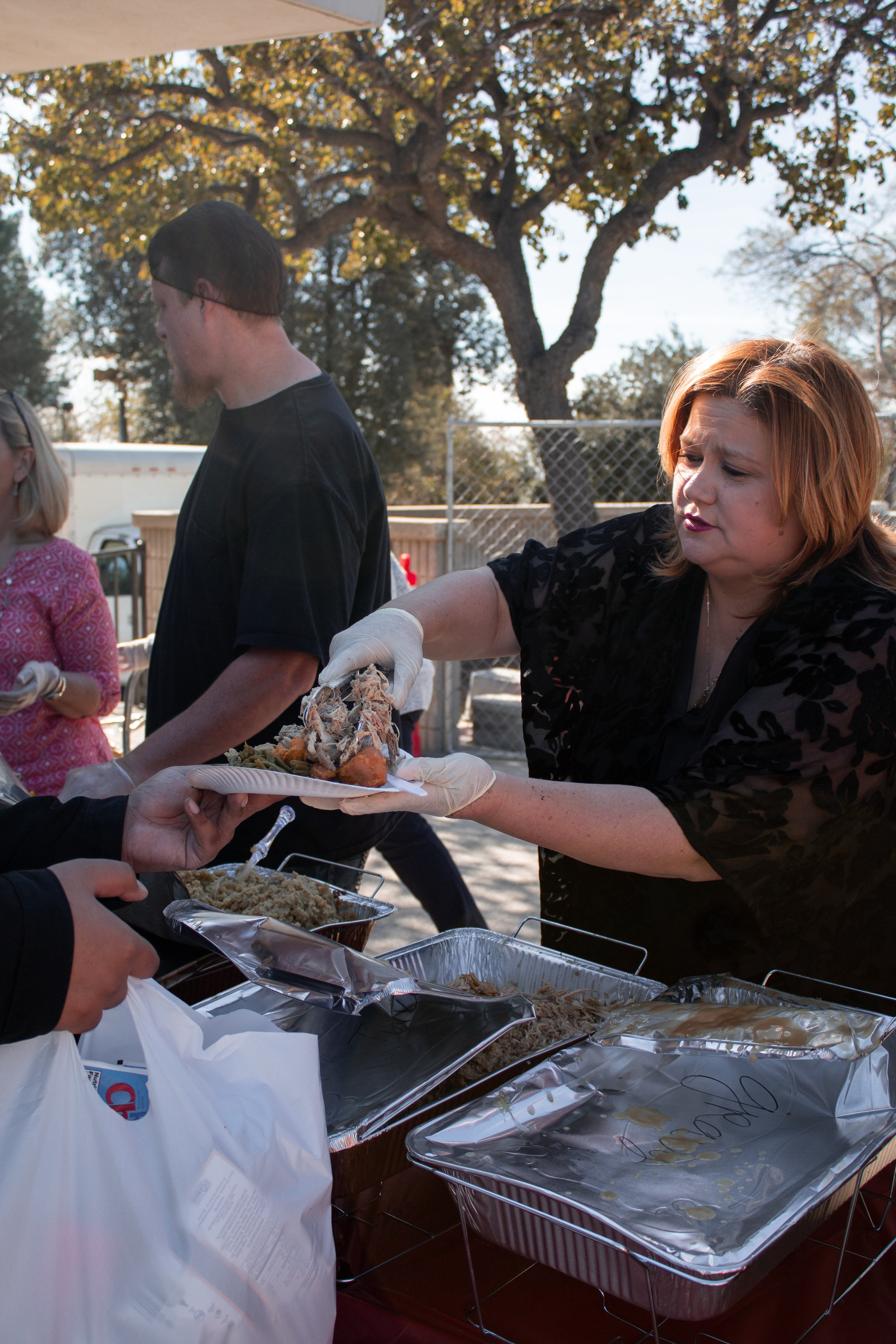 Manager of Special Populations and Equity Programs, Lorena Corona, serving Chaffey students free Thanksgiving meals. Photo Credit: Raylene Camerano