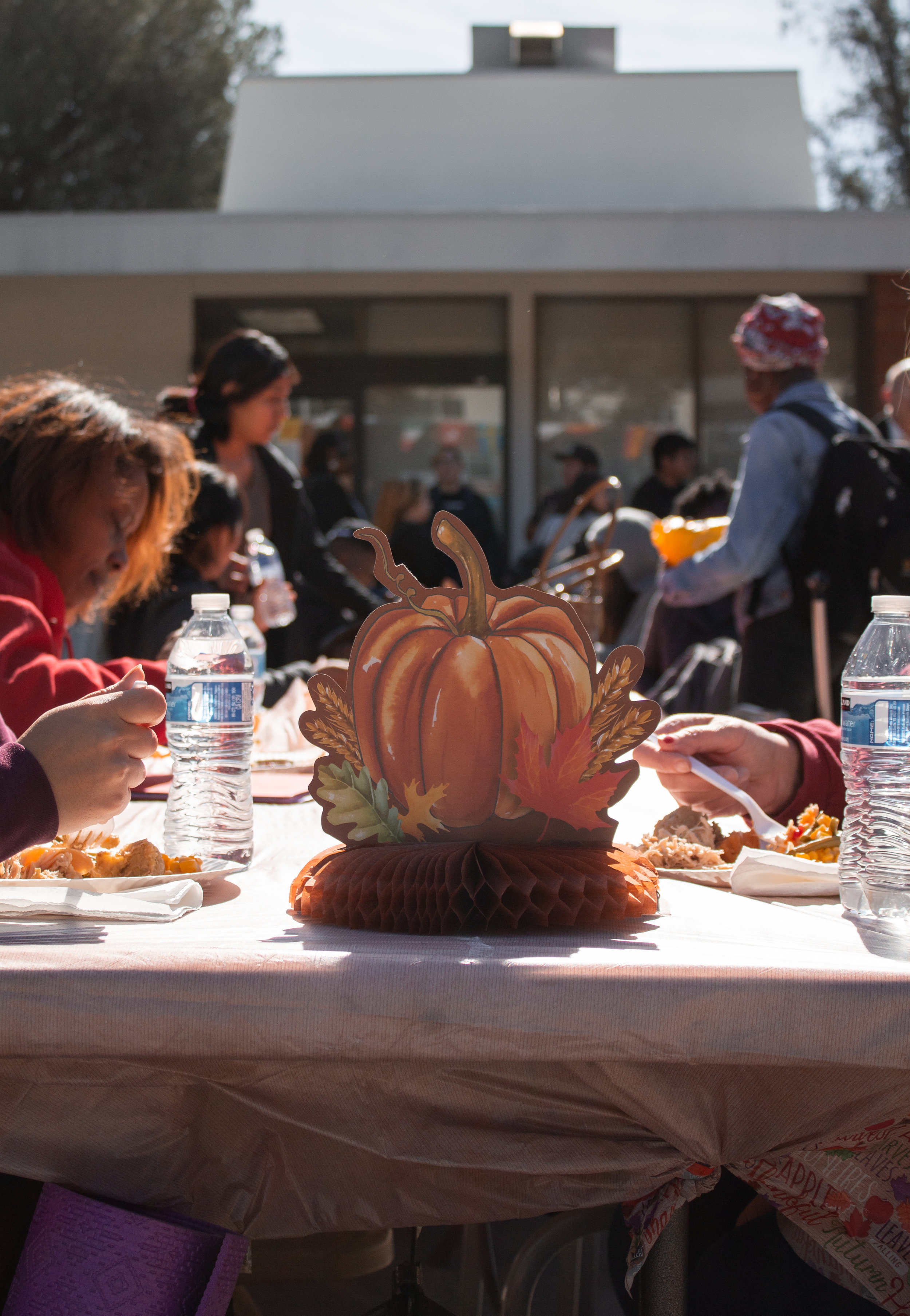 The students of Chaffey gather at a table in the quad for a Thanksgiving meal provided by Eat and Be Well. Photo Credit: Raylene Camerano
