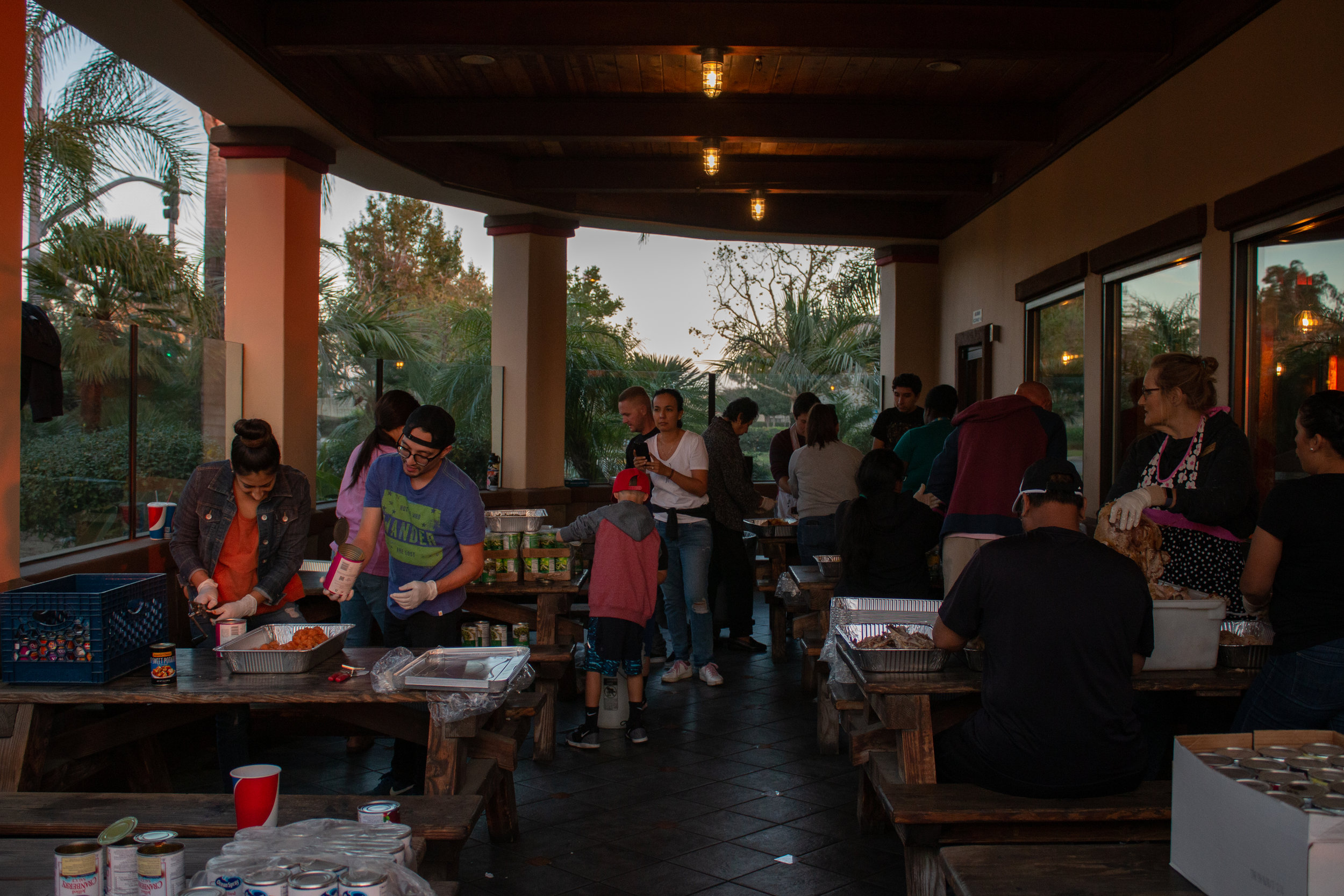 The community of Rancho Cucamonga preparing free meals for Chaffey College students. Photo Credit: Raylene Camerano