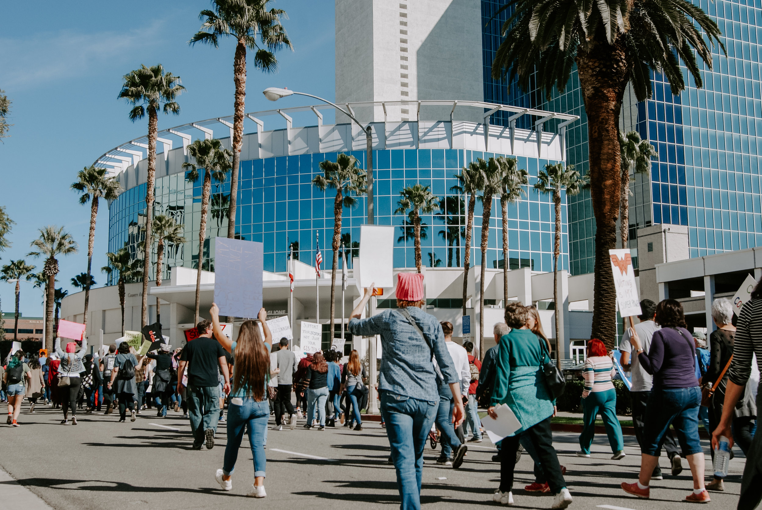 Women and men hold their posters and chant while marching down the streets of Riverside, California. The march started at 11 a.m., after spokespeople rallied up attendees. Photo by Tommy Stiles.