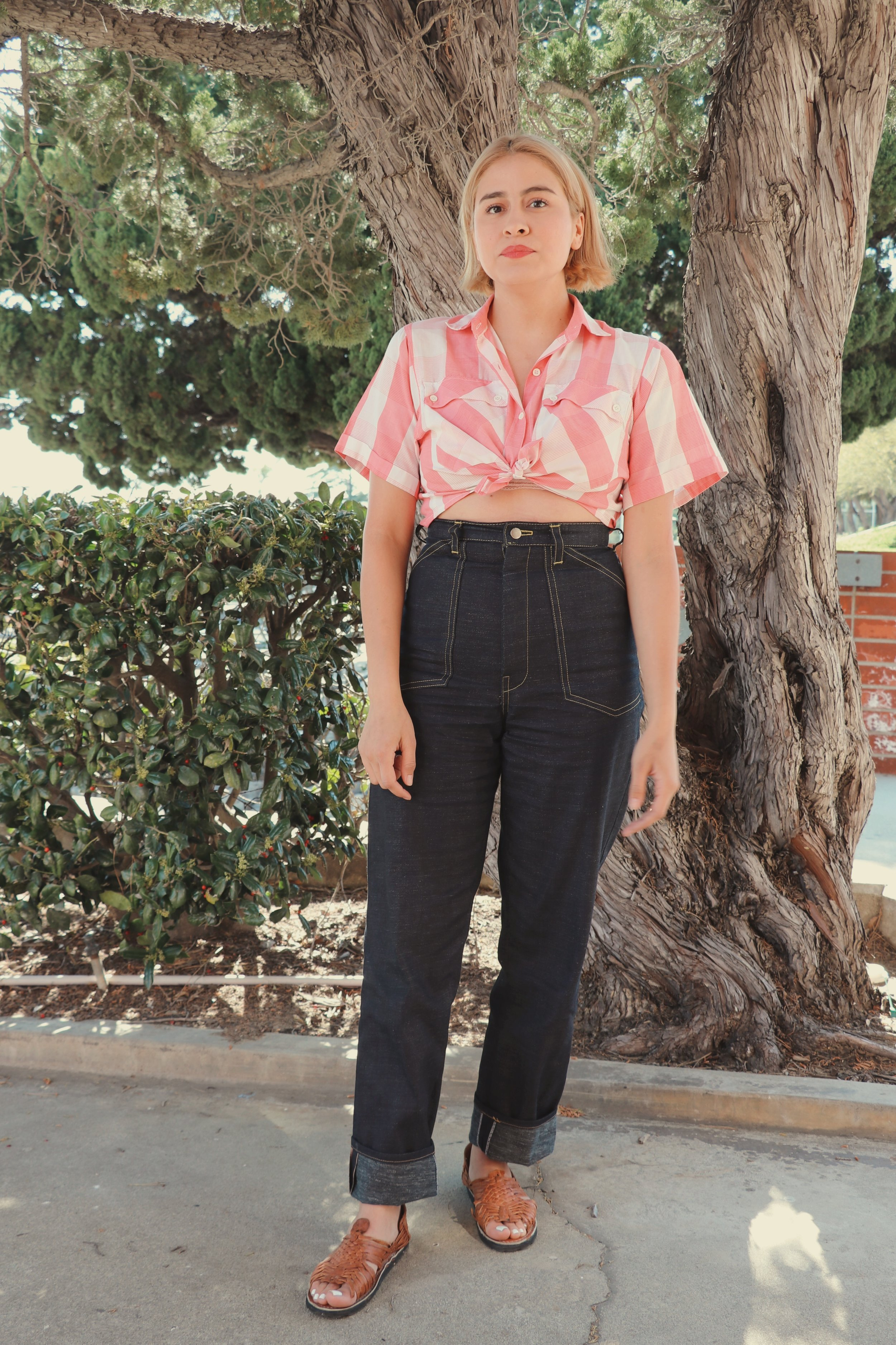 Chaffey student Michelle Macias pairs high waisted pants with a collared cropped top for a boho indie look.