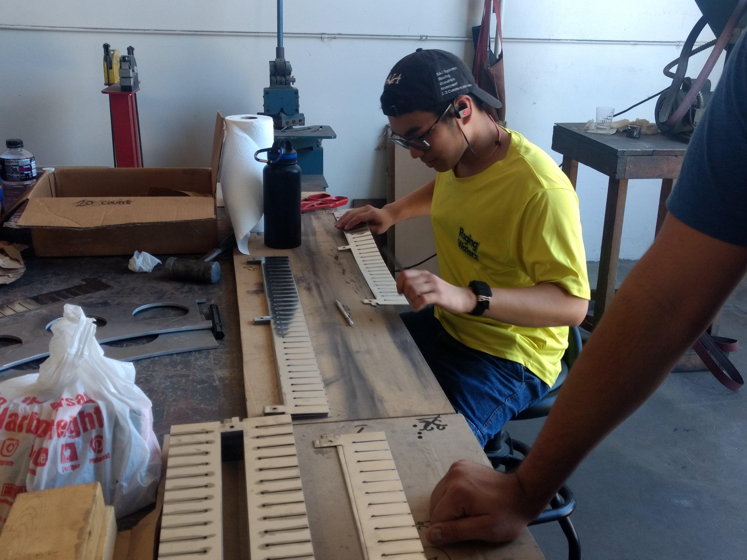 Stephen Adilukito examining parts for any damage. Photos by Brody Salazar.
