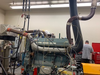 A dynamometer hooked up to an engine for emissions testing.