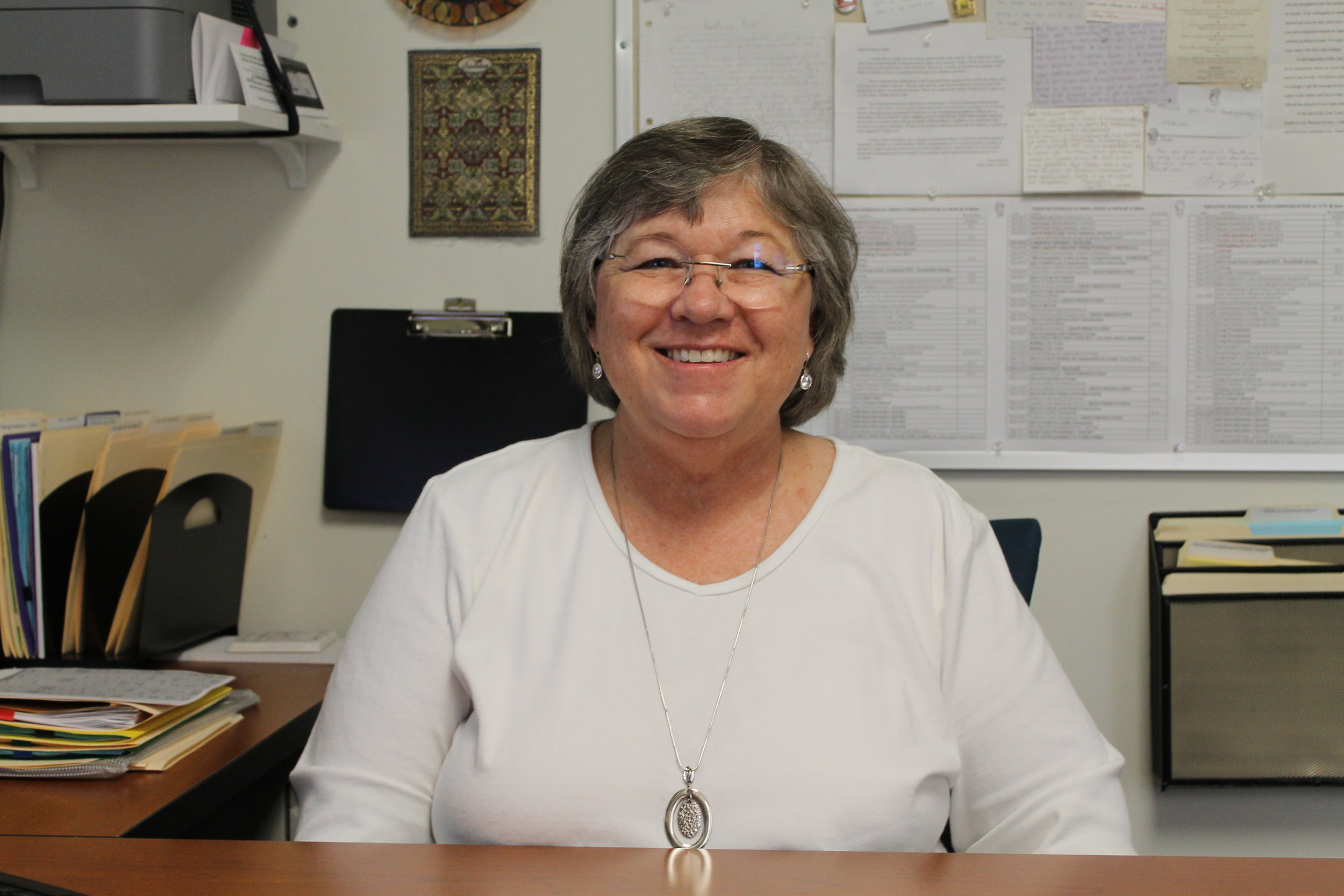Professor Pratt smiles in the comfort of her office. Photo by Lila Cano.
