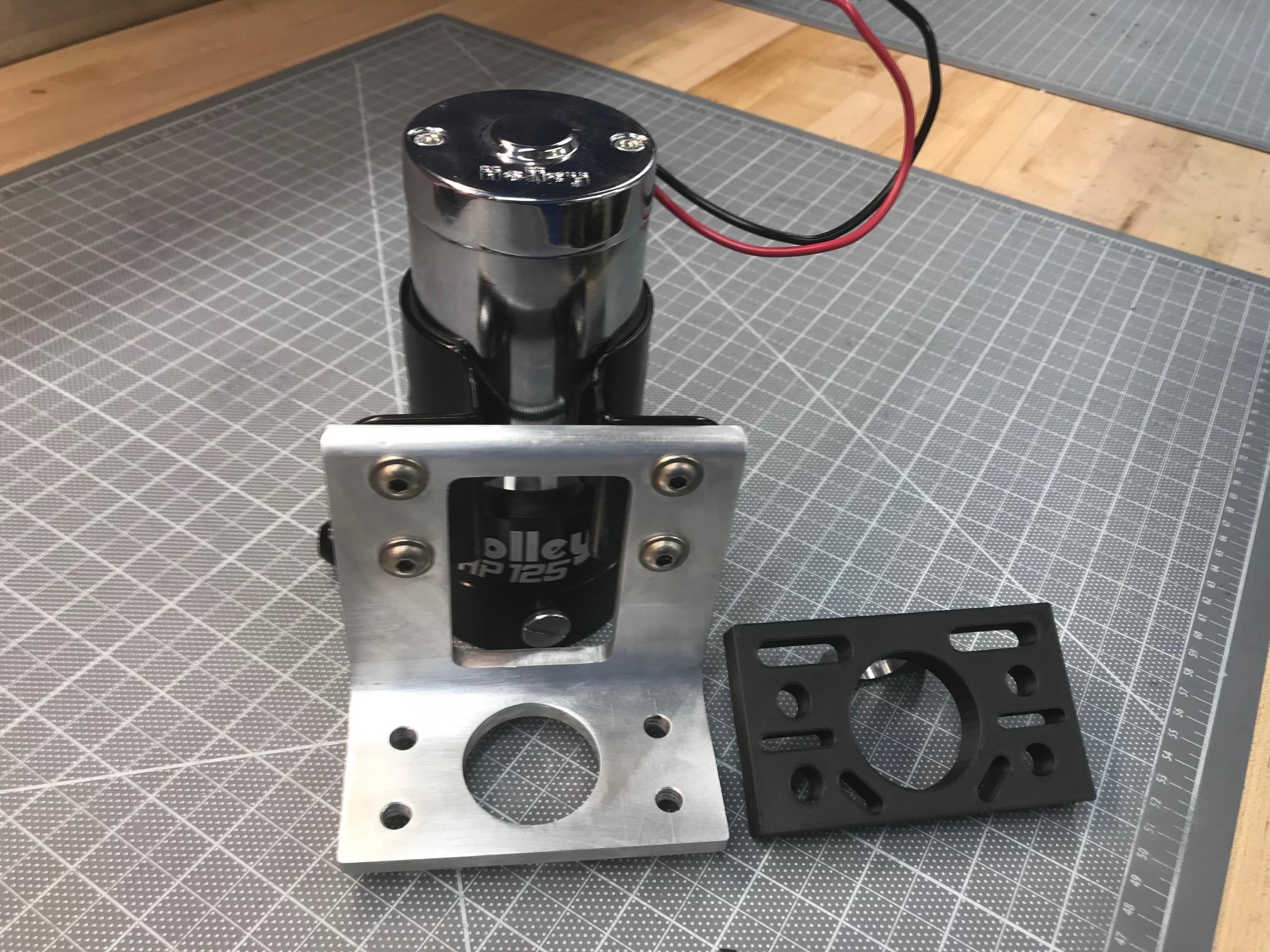 Pump mounted to bracket; custom 3D-printed spacer