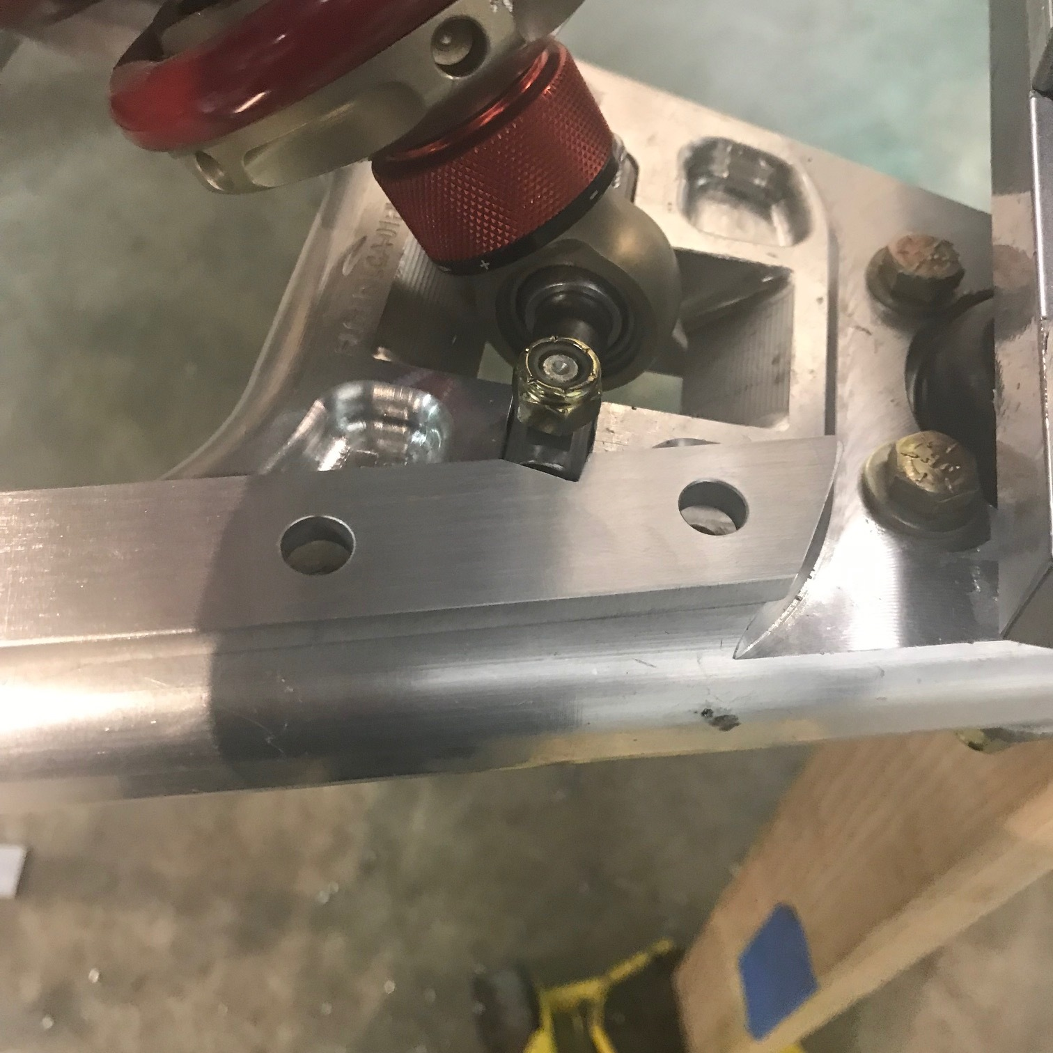 Spacer notched around shock mounting pin