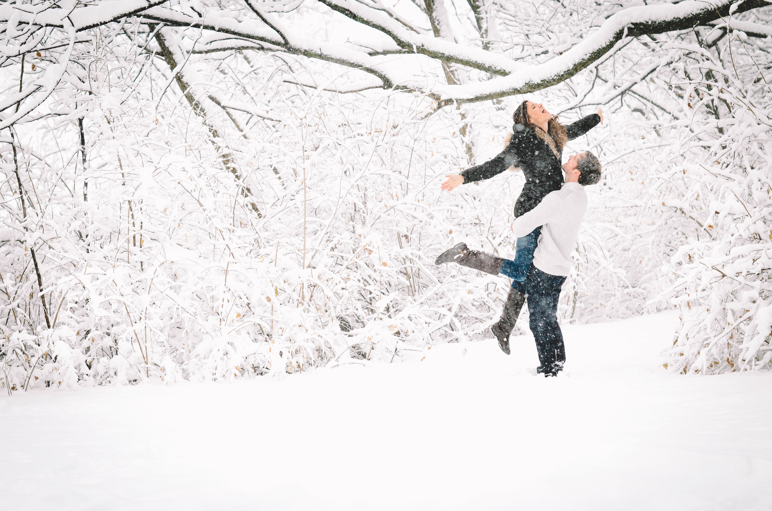 Nathan + Rebekah's Wintry Snowfall Engagement