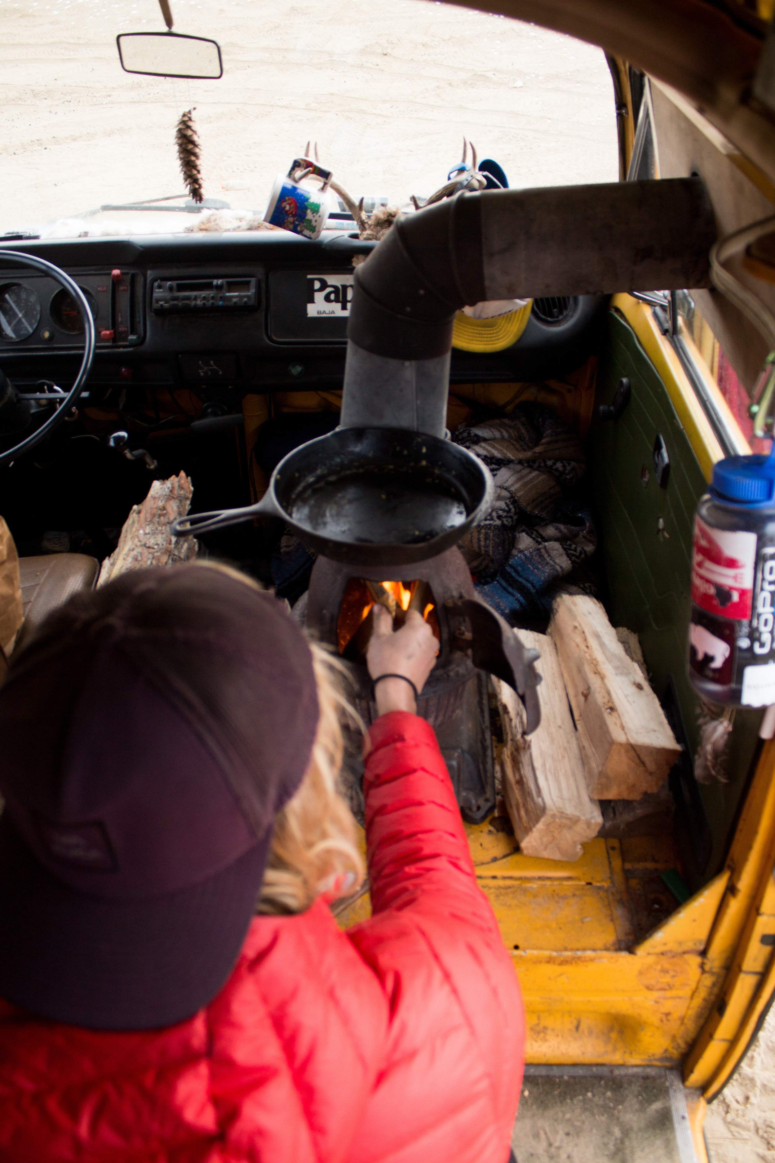 James is from PA, so he's used to colder weather, but it's different when you live in a tin box. In the colder months, James trades his garden for a wood-burning stove.