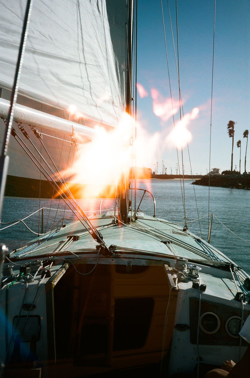 Launching fireworks off a boat in the harbor. Just kidding... This is a photo of a fire shot over a photo of sailing out of Channel Islands harbor.